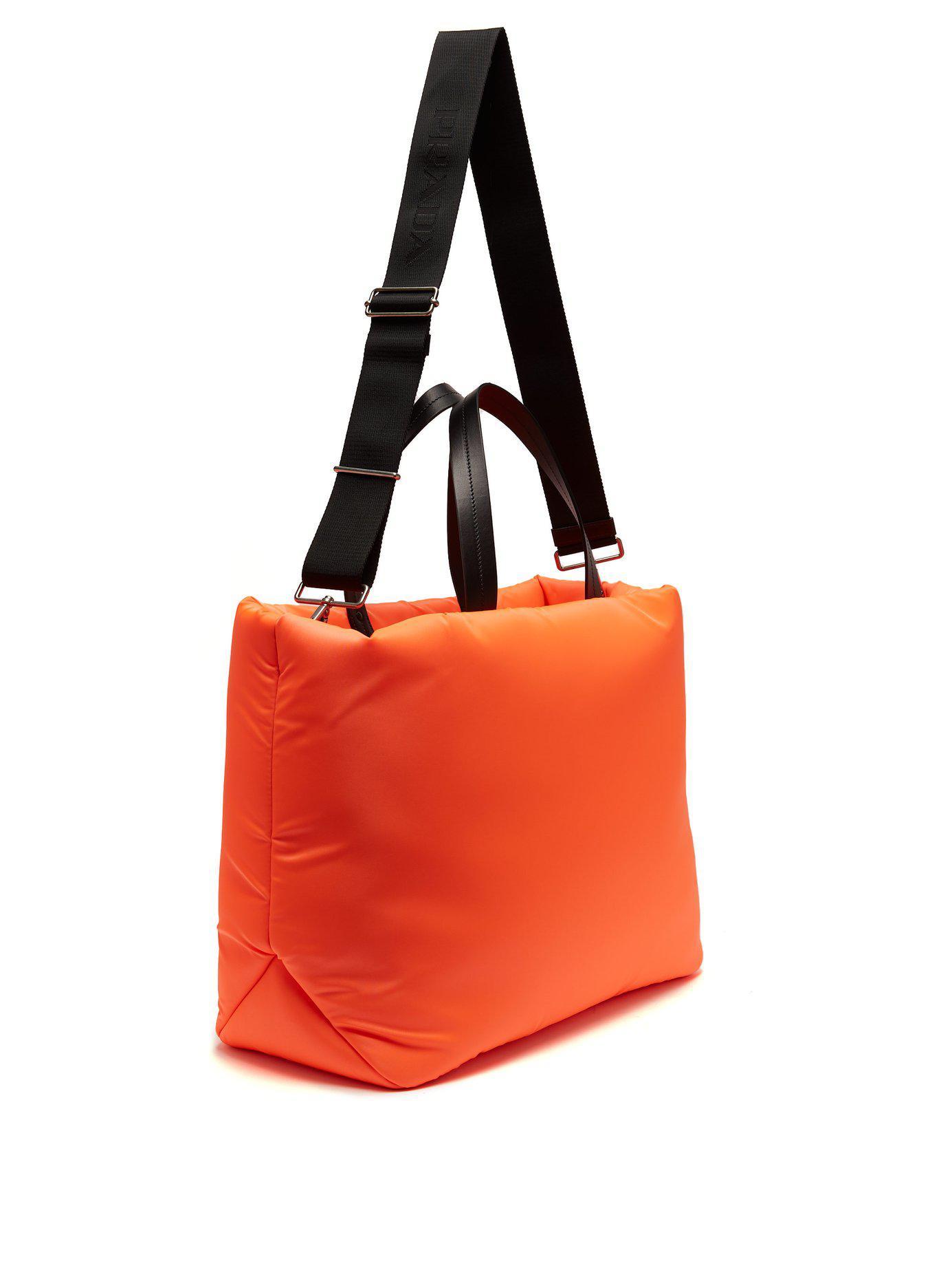 374b2f5c526e Prada Logo Embellished Padded Nylon Tote Bag in Orange - Lyst
