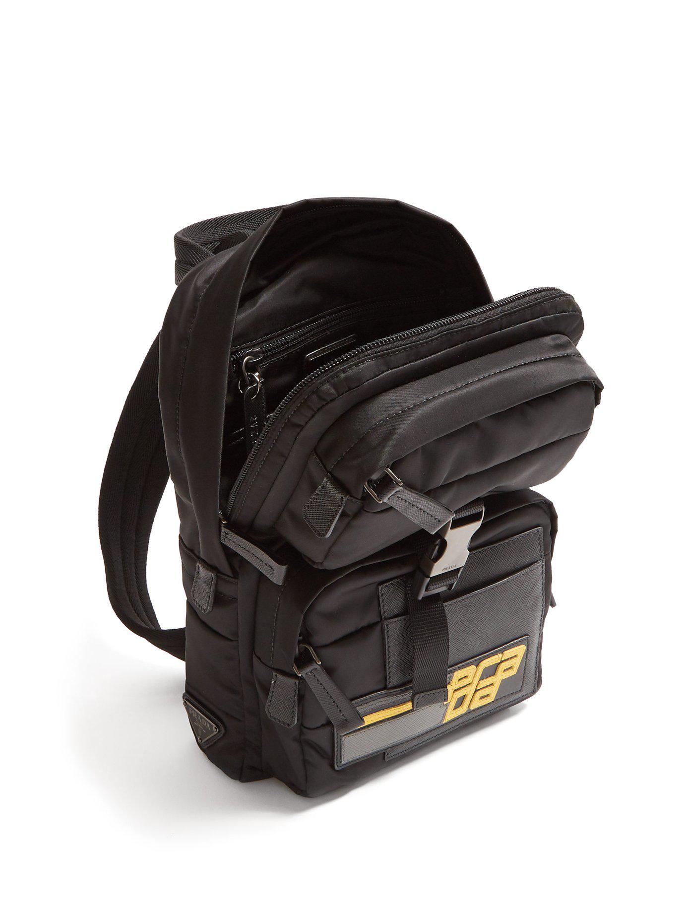 44b59f48ab81 Prada - Black Logo Patch Nylon Backpack for Men - Lyst. View fullscreen