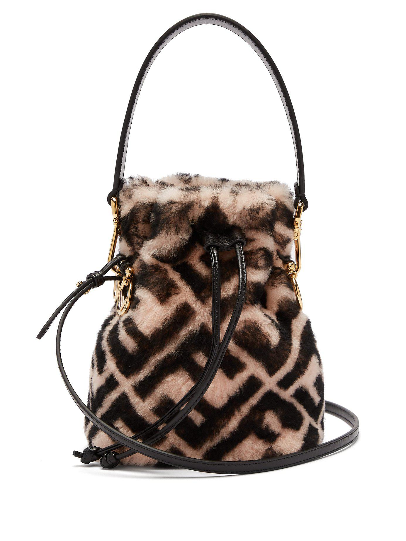 f5f1f9b4c0f3 Lyst - Fendi Mon Tresor Logo Print Shearling Bucket Bag