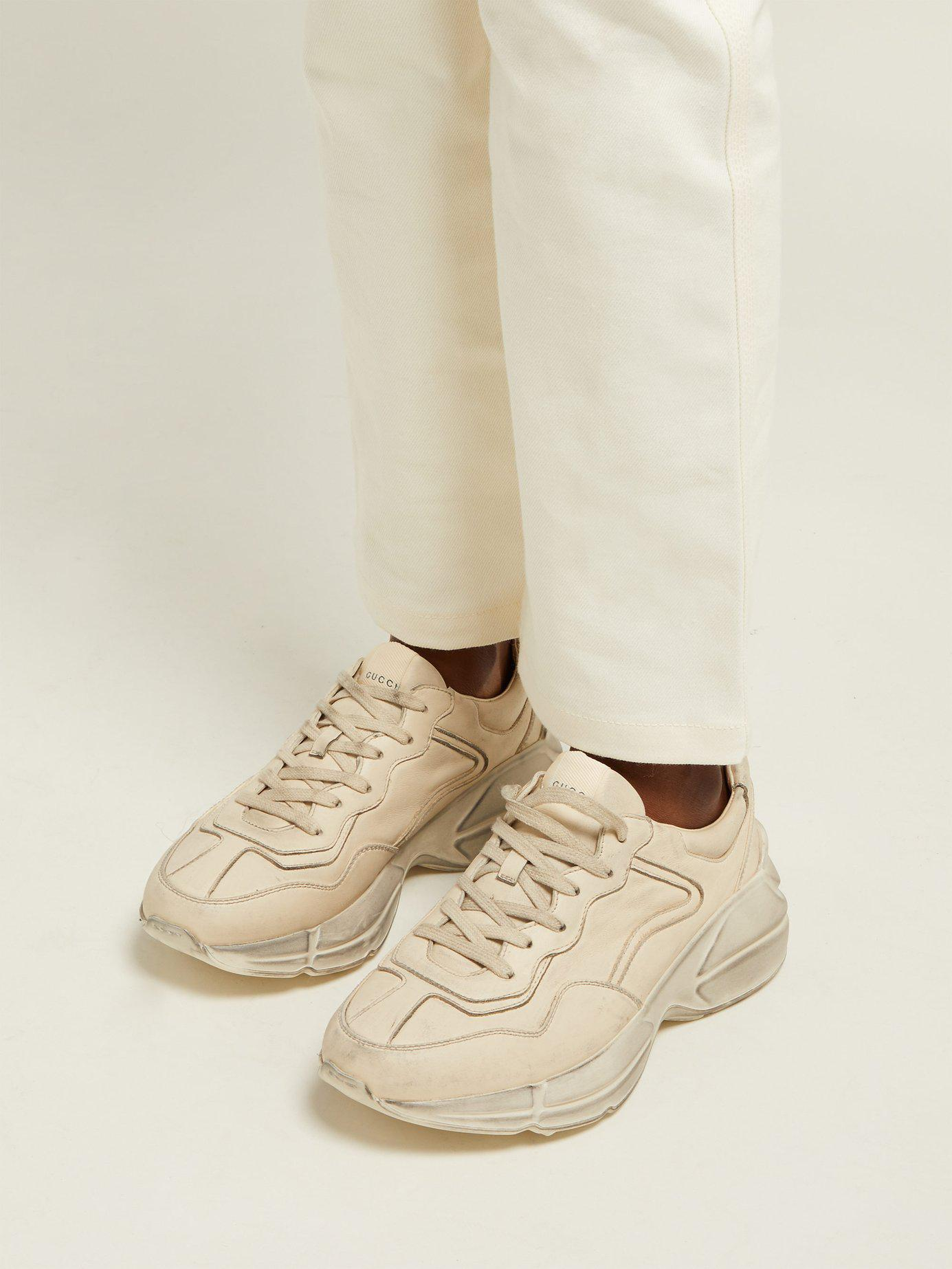 389bd8870cc Lyst - Gucci Rhyton Worn Effect Low Top Leather Trainers in Natural