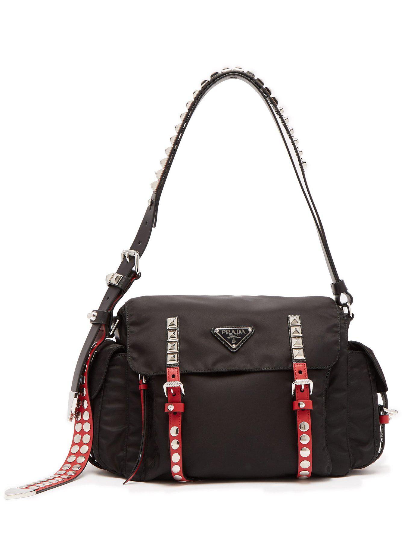 d8a48280b6f7 Prada Vela Leather Trimmed Cross Body Bag in Black - Lyst