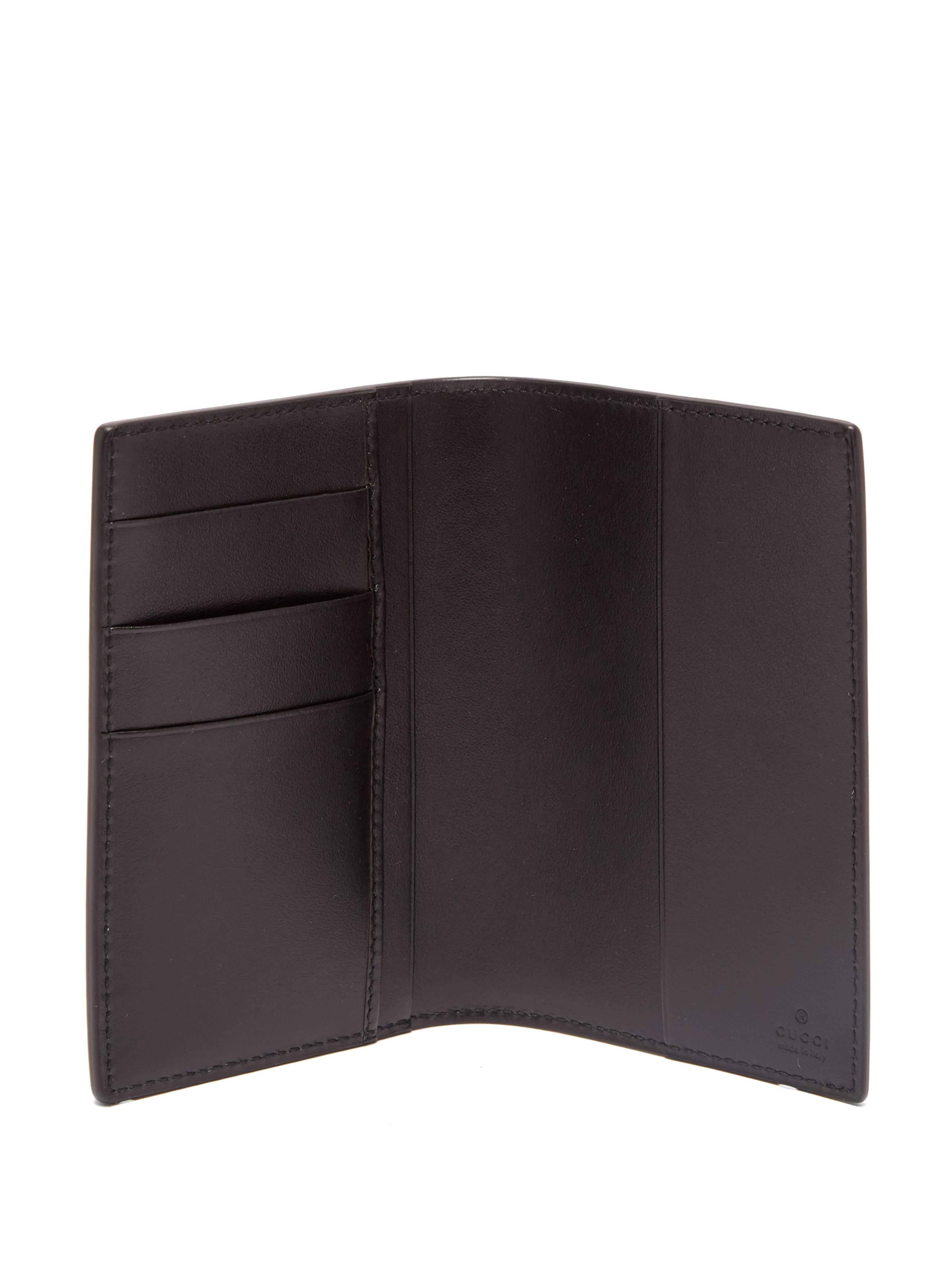 76b5cb78d834 Gucci Logo Leather Passport Holder in Black for Men - Lyst