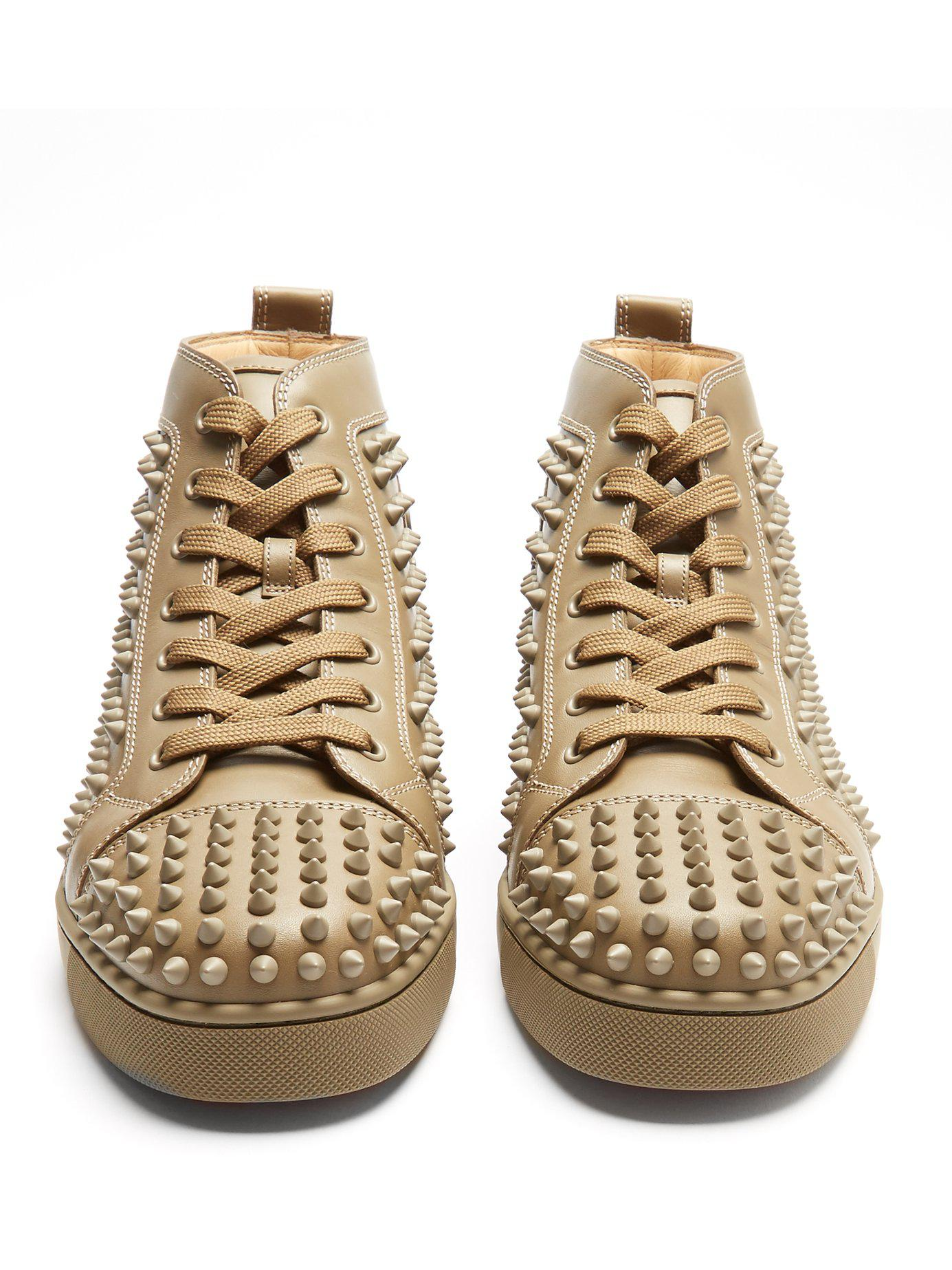 99fdaf3e9299 Lyst - Christian Louboutin Louis Spike Embellished High Top Trainers ...