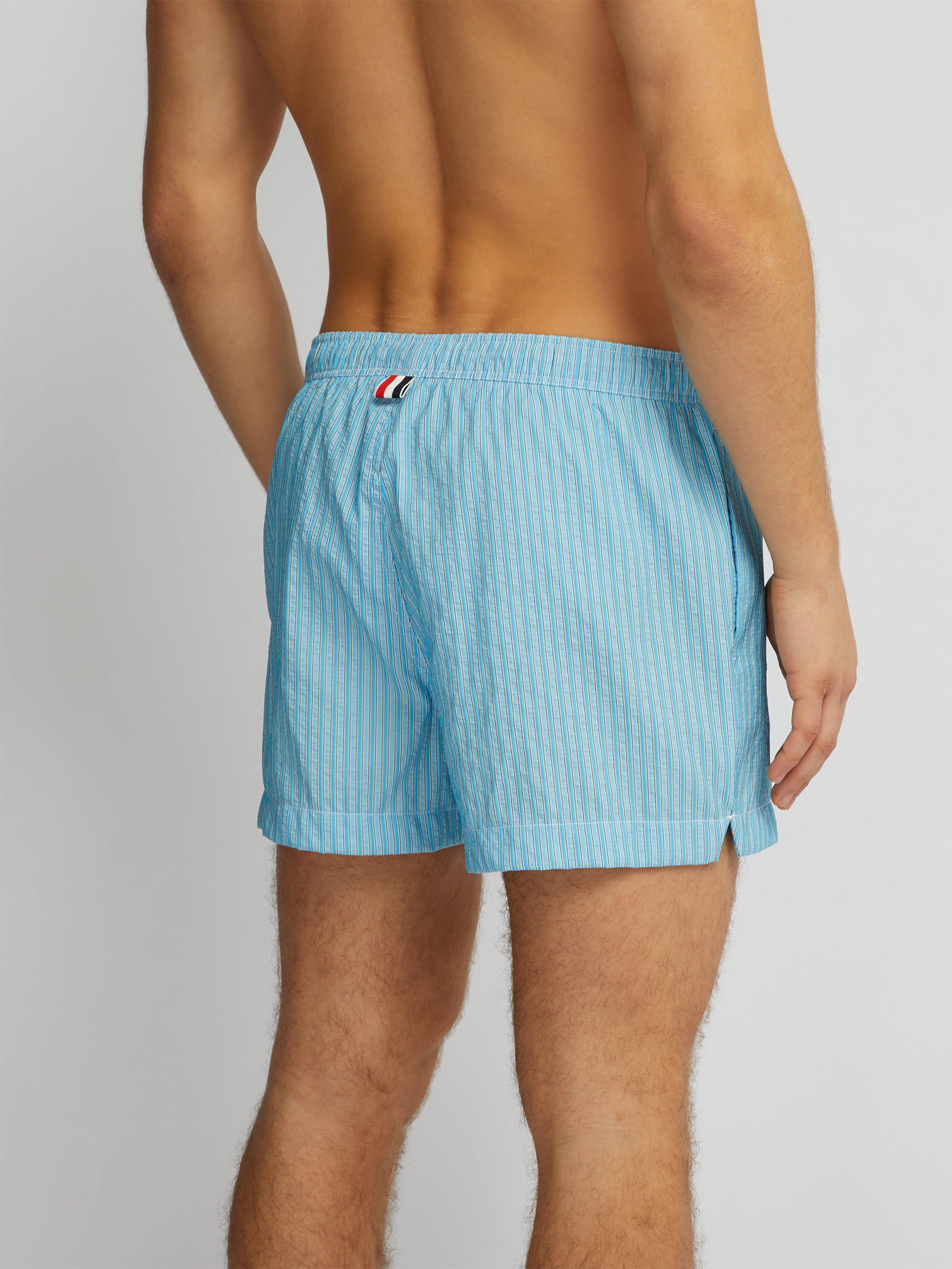 7ec0729a3e3ea Thom Browne - Blue Logo Patch Striped Seersucker Swim Shorts for Men -  Lyst. View fullscreen
