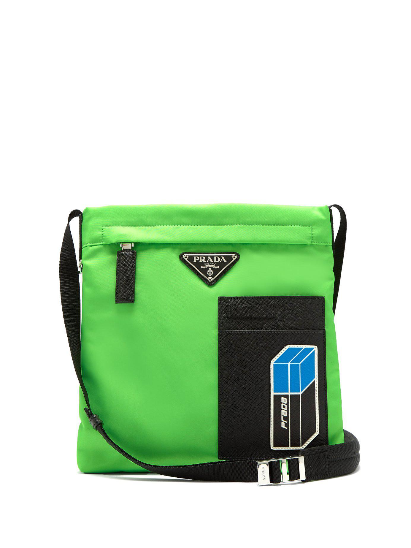 7d3fc5c1318887 ... buy prada green logo plaque nylon cross body bag for men lyst. view  fullscreen d125b