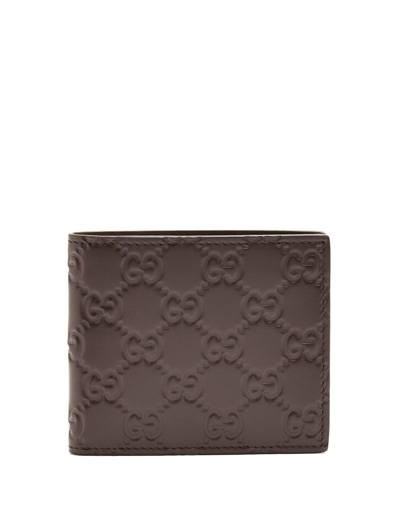 75458e014b74 Lyst - Gucci Gg Debossed Bi Fold Leather Wallet in Brown for Men