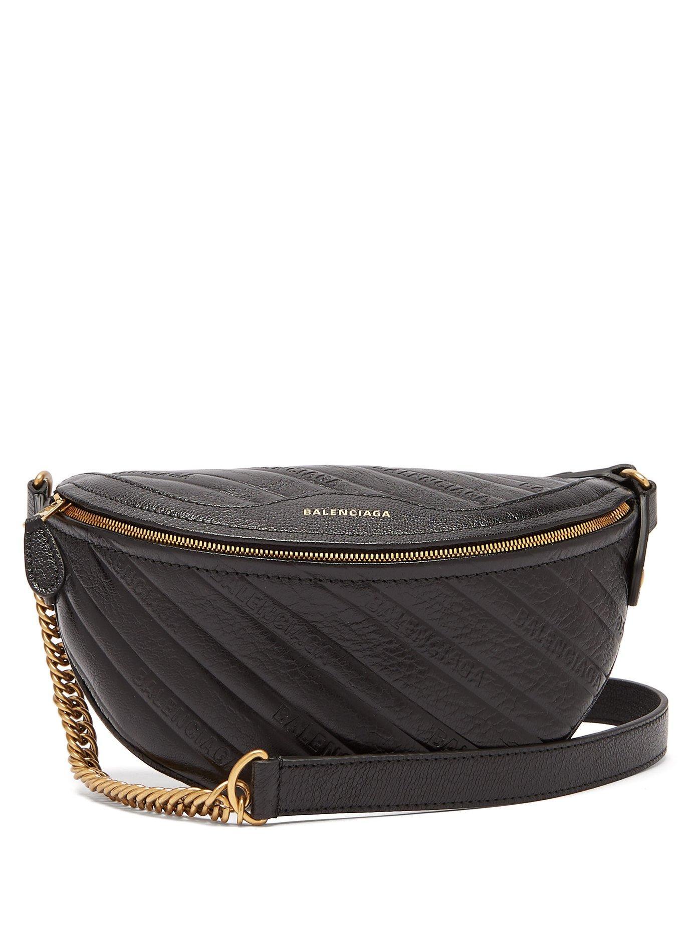 b185c2f7b44 Balenciaga - Black Souvenirs Xxs Logo Debossed Leather Belt Bag - Lyst.  View fullscreen