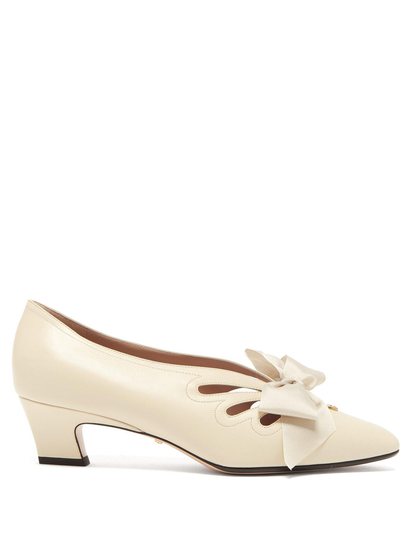 43b14d49643 Lyst - Gucci Berith Bow Leather Pumps in Natural