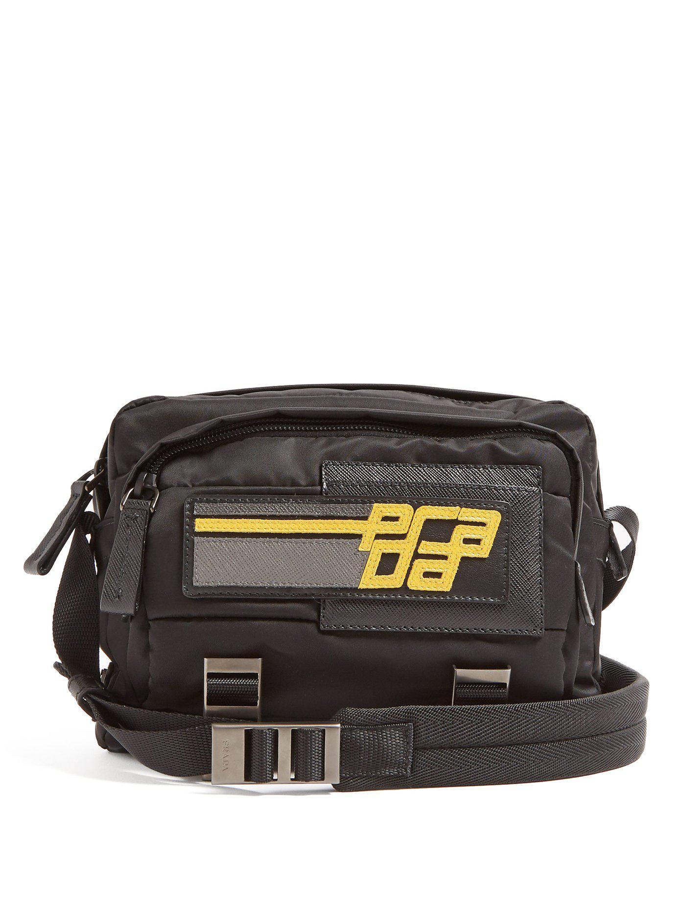 Lyst - Prada Logo Patch Nylon Cross Body Bag in Black for Men 853f0759b1616