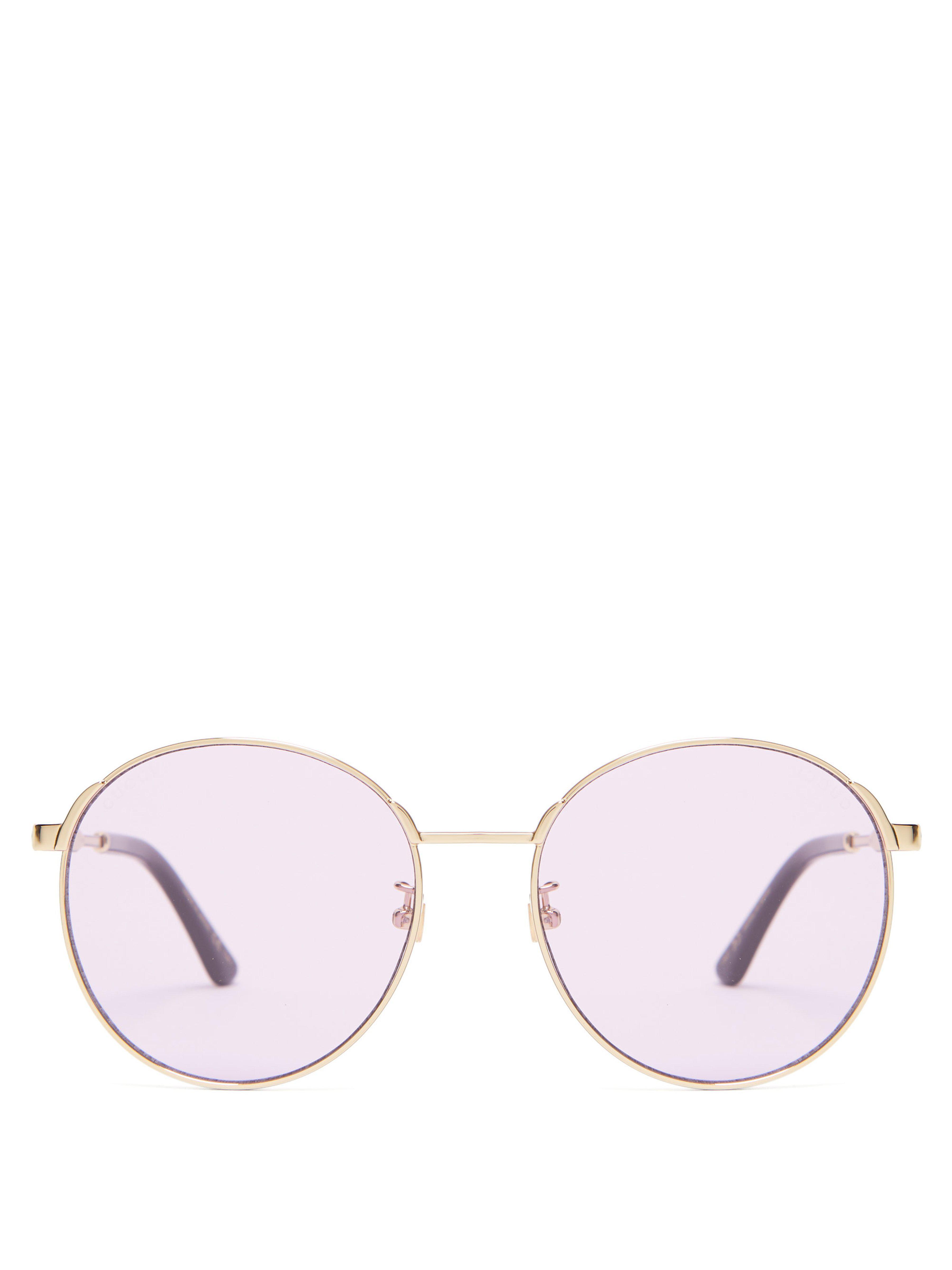 73db099ec30 Gucci. Women s Round Frame Metal Sunglasses