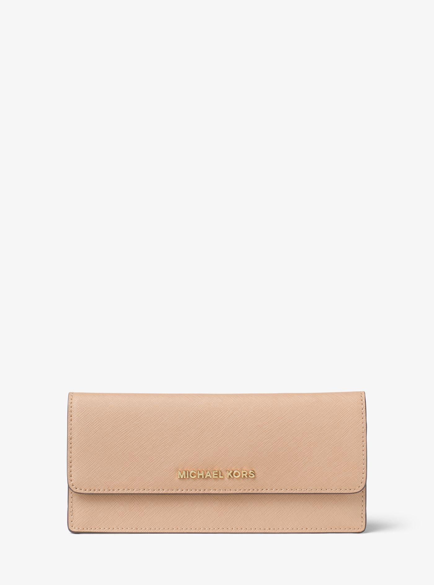09841c6b28bd Lyst - Michael Kors Travel Slim Saffiano Leather Wallet in Natural