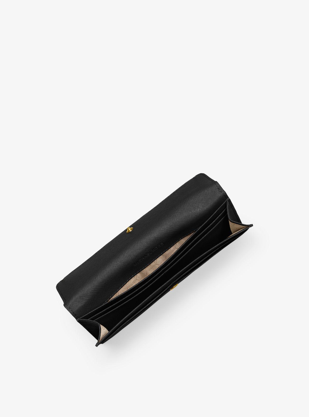 44f726d843e Michael Kors Travel Slim Saffiano Leather Wallet in Black - Lyst