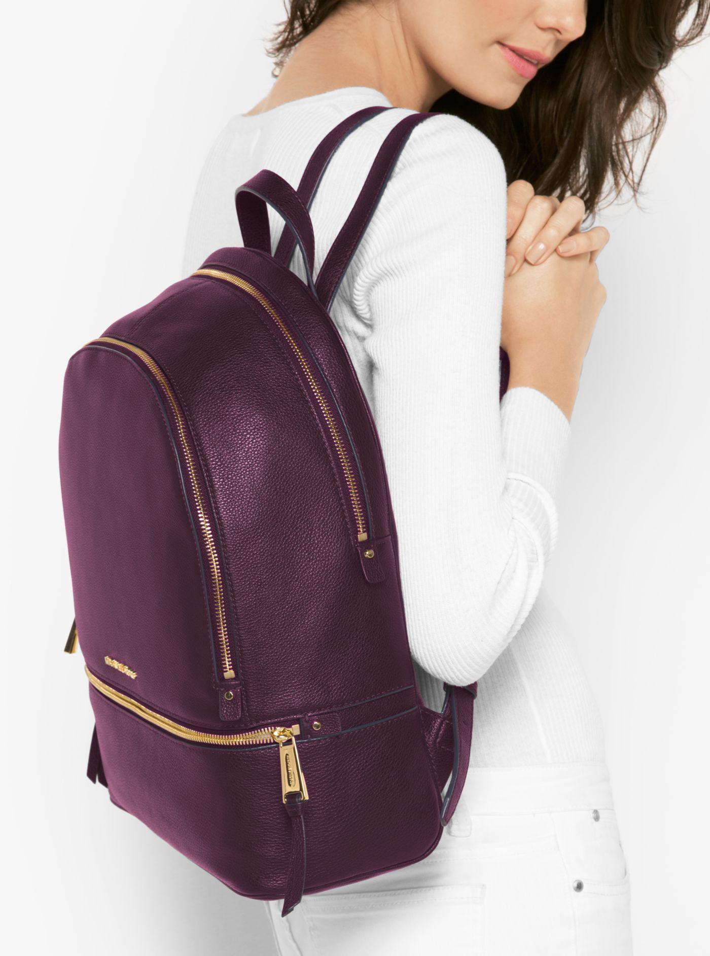 54cdba1caa05 ... release date lyst michael kors rhea large leather backpack in purple  f91aa 41318
