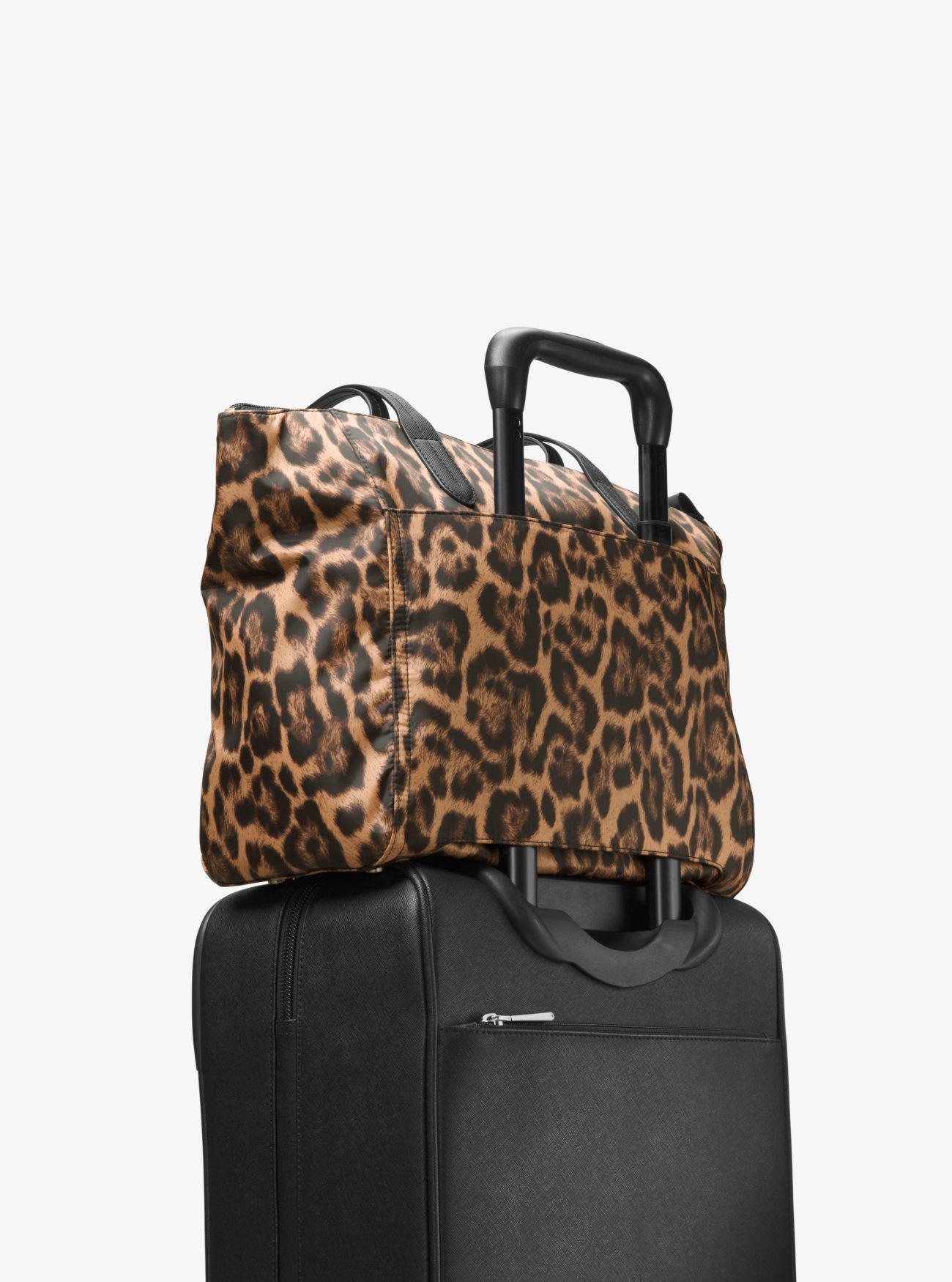 12234cf87a38 Lyst - Michael Kors Kelsey Leopard Nylon Tote