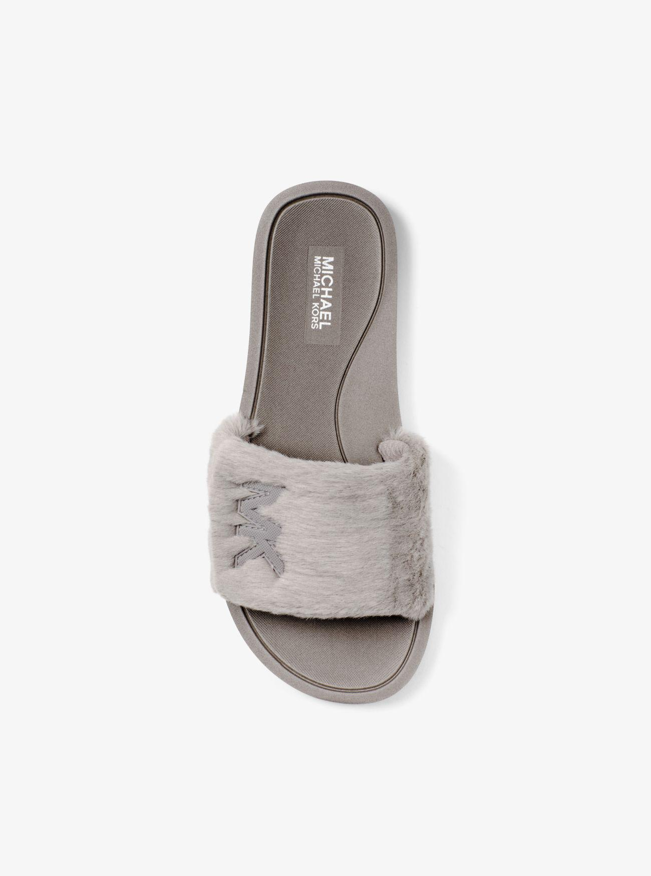 5730bf6a16fc Lyst - Michael Kors Logo Faux Fur Slide in Gray