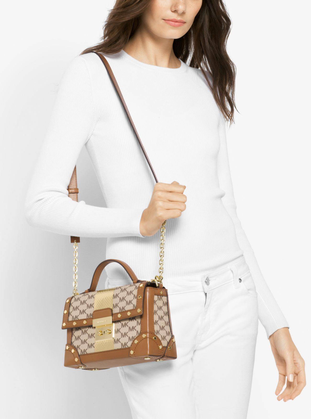 834653a65e1b Lyst - Michael Kors Cori Small Heritage Signature Trunk Bag in Natural