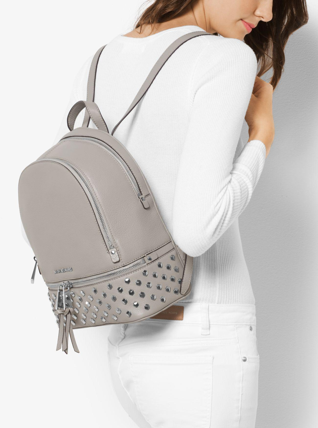 1497e7306528 Michael Kors Rhea Medium Studded Leather Backpack in Gray - Lyst