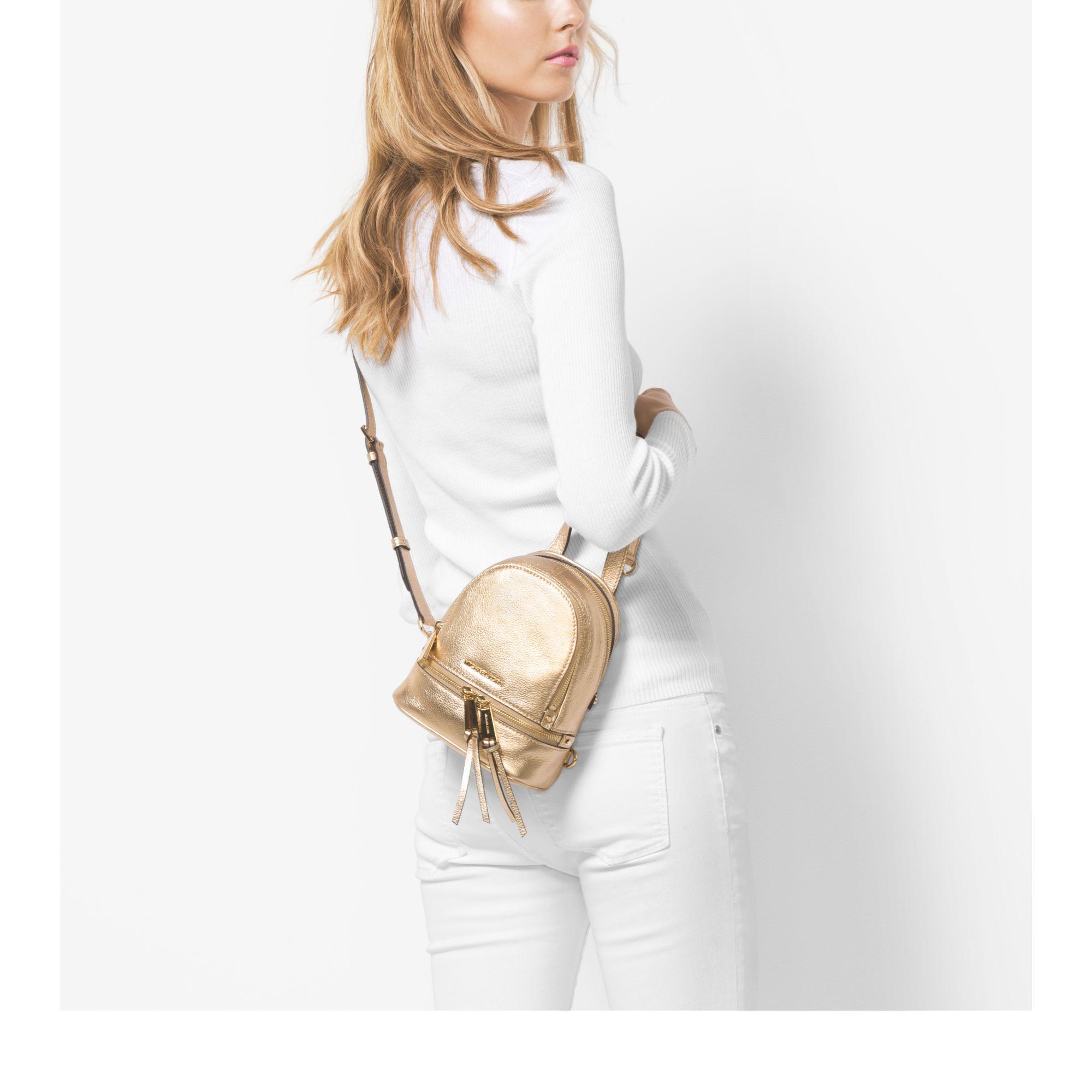 f53ea495d4fd Michael Kors Rhea Extra-small Metallic Leather Backpack in Metallic - Lyst