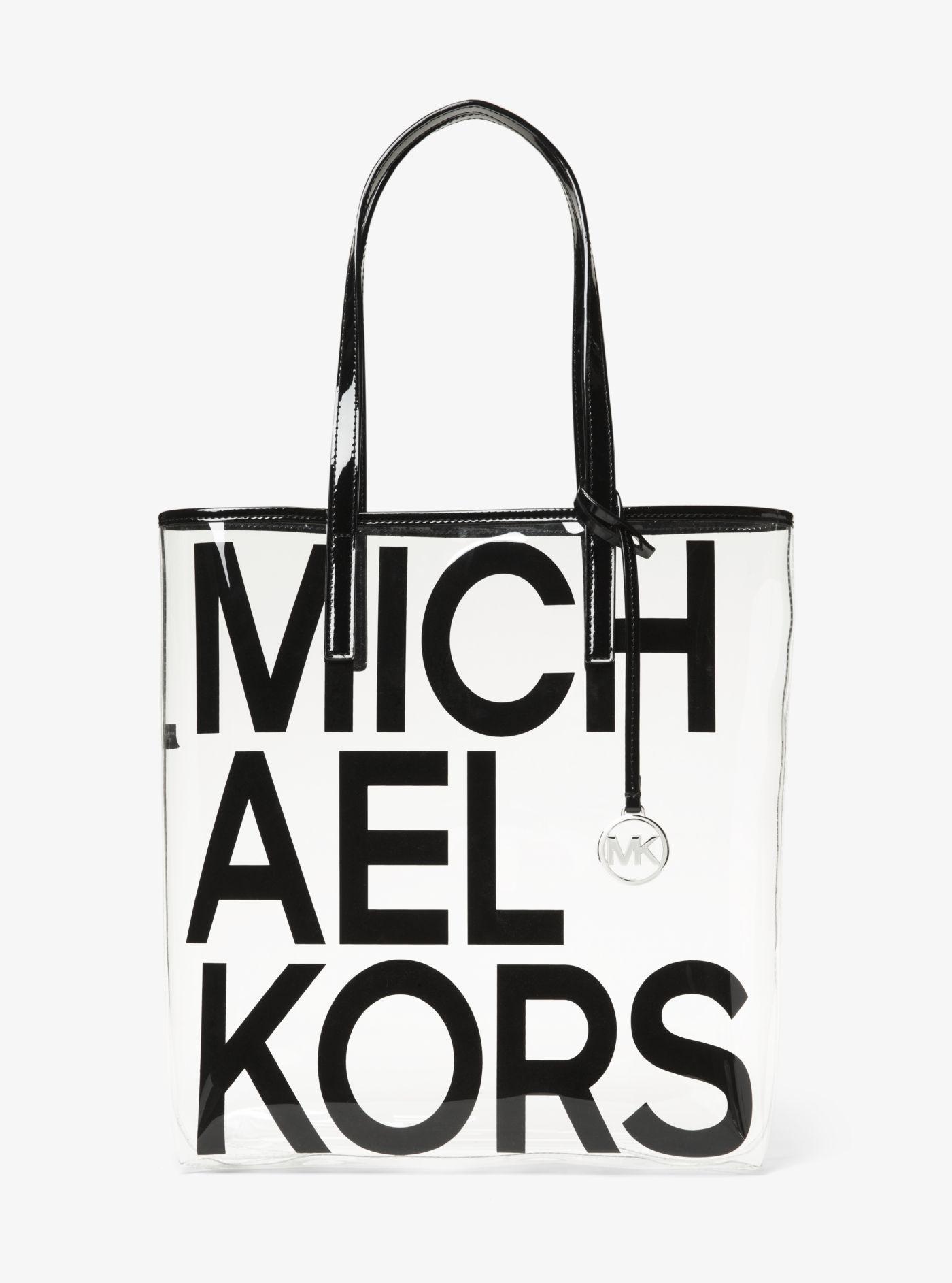51620e522f03d1 ... get michael kors black the michael large graphic logo print clear tote  lyst. view fullscreen