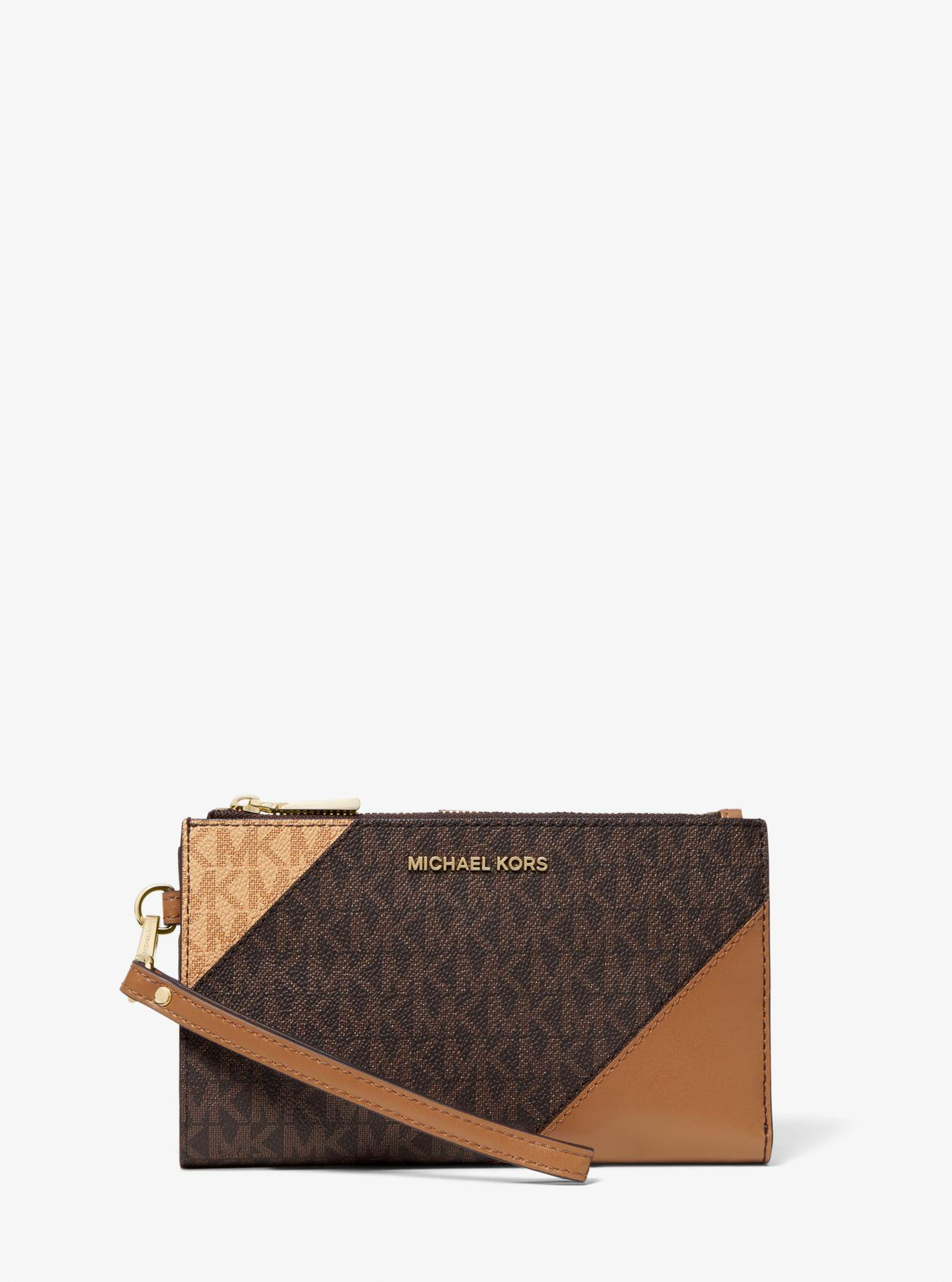Michael Kors - Brown Adele Two-tone Logo And Leather Smartphone Wallet -  Lyst. View fullscreen 7f70ea2b788c4