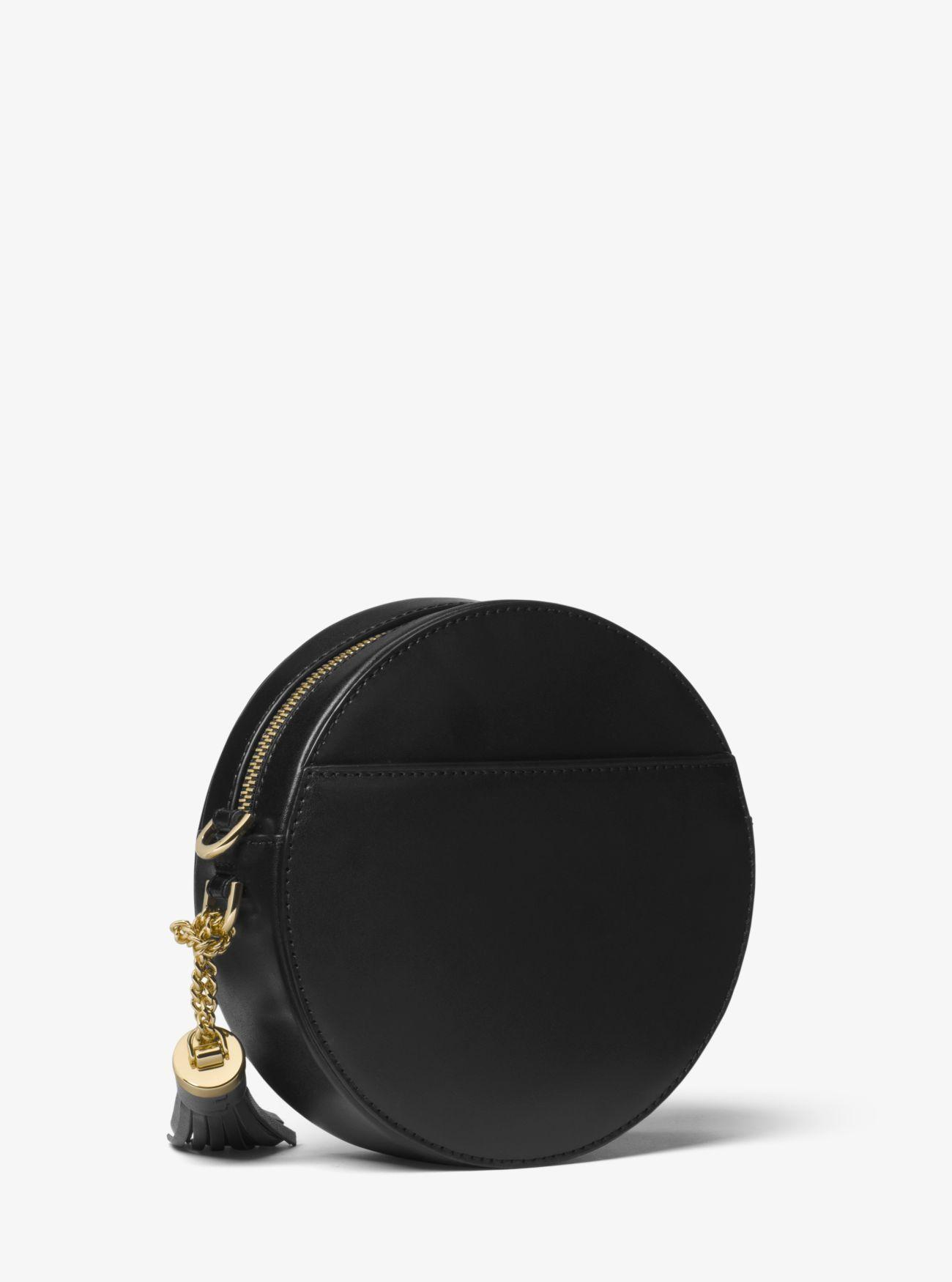 f5d1a9b8afc0 Michael Kors Studded Leather Canteen Crossbody Bag in Black - Lyst