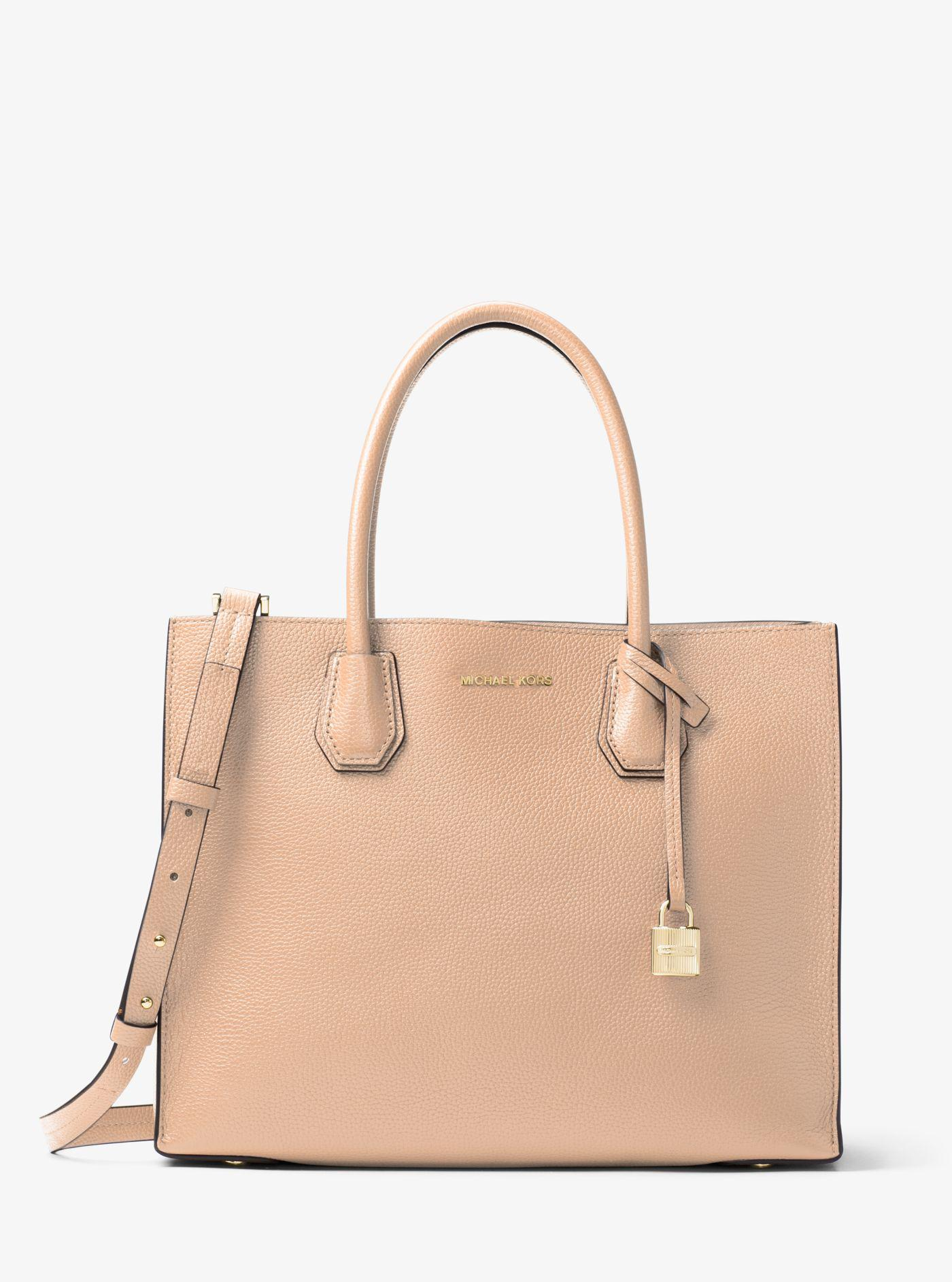 69a69986ff9f7 ... low price lyst michael kors mercer large leather tote in natural 39394  2de36 ...