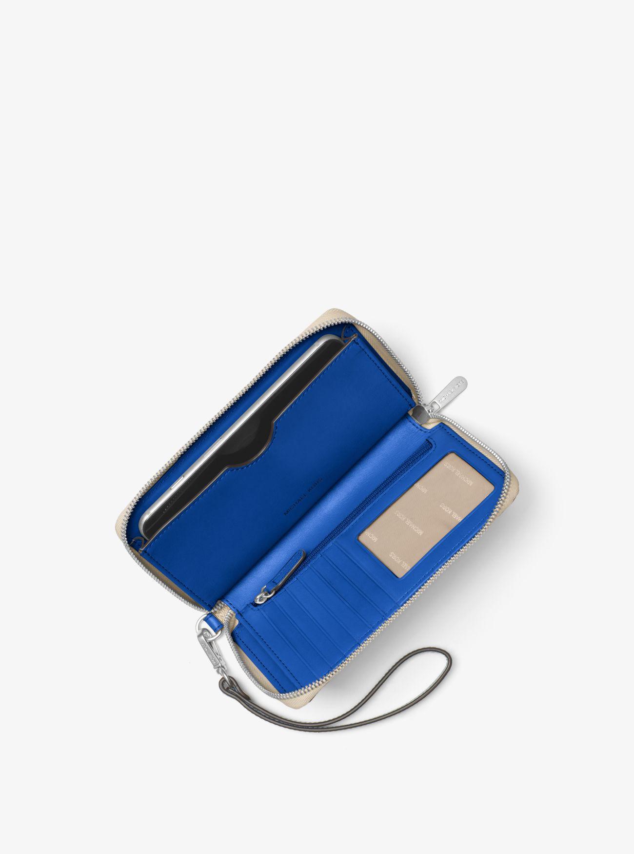15a67c4417d3 Lyst - Michael Kors Jet Set Travel Large Logo Wallet in Blue