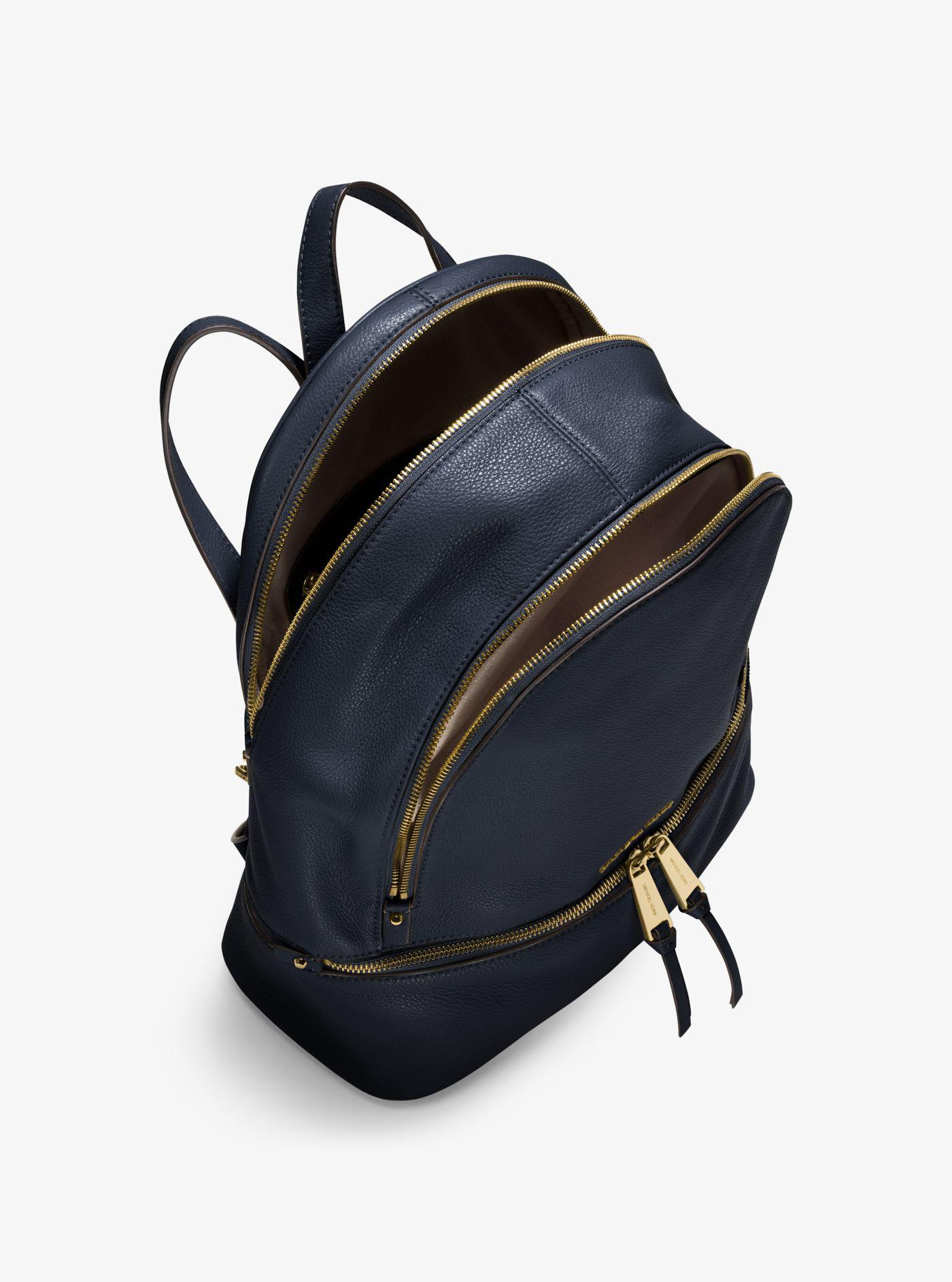 013a99a9f902 ... free shipping michael kors blue rhea large leather backpack lyst. view  fullscreen c1166 cebd4