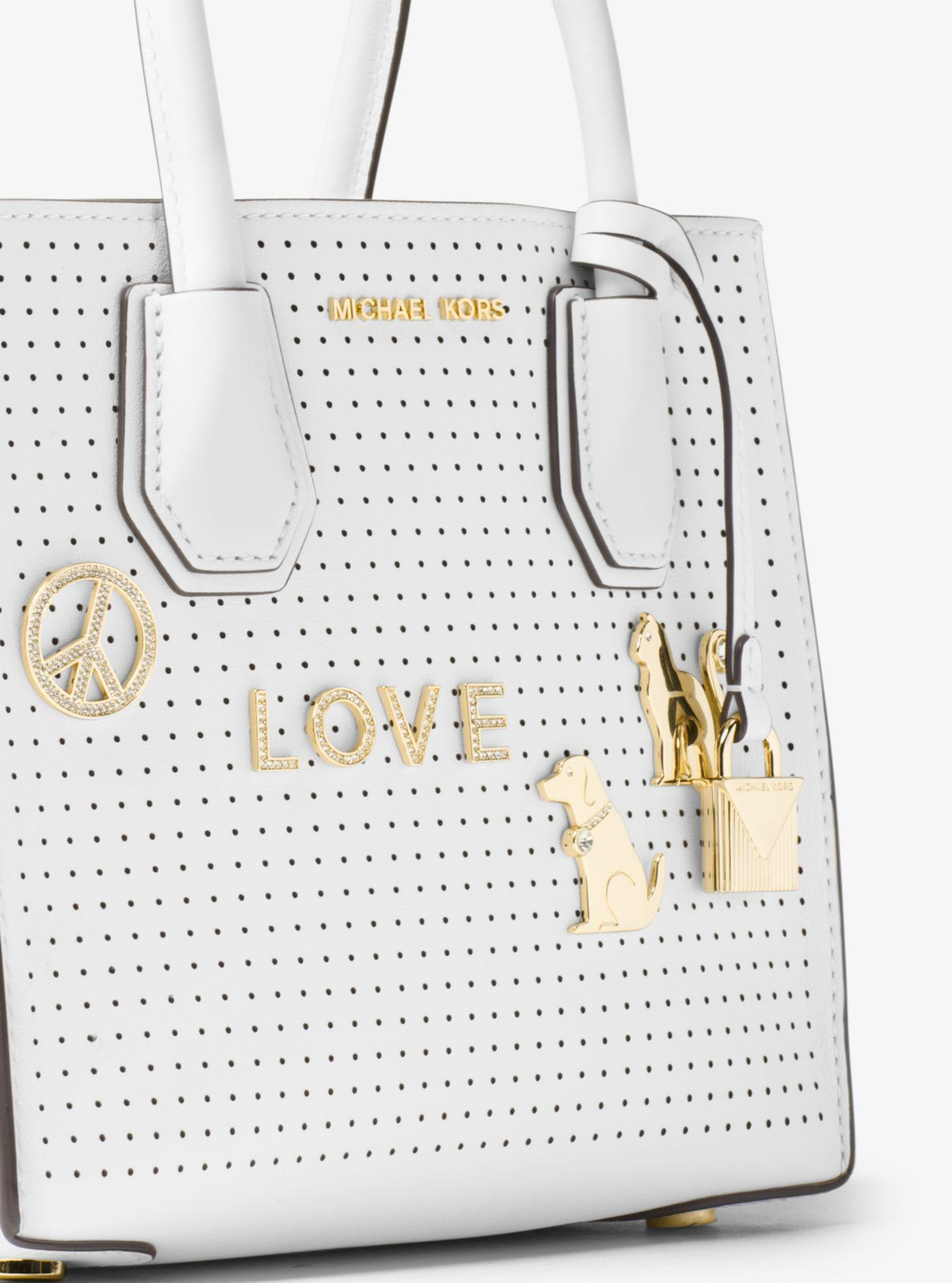 a170206ce135 Michael Kors Mercer Perforated Leather Crossbody Bag in White - Lyst