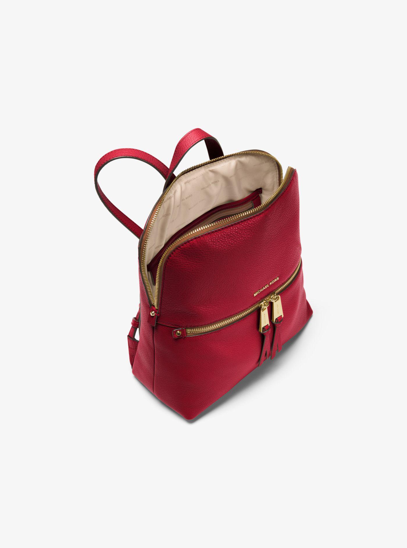 f55c4a6b7ae0 ... sale lyst michael kors rhea medium slim leather backpack in red 604a2  d10b6