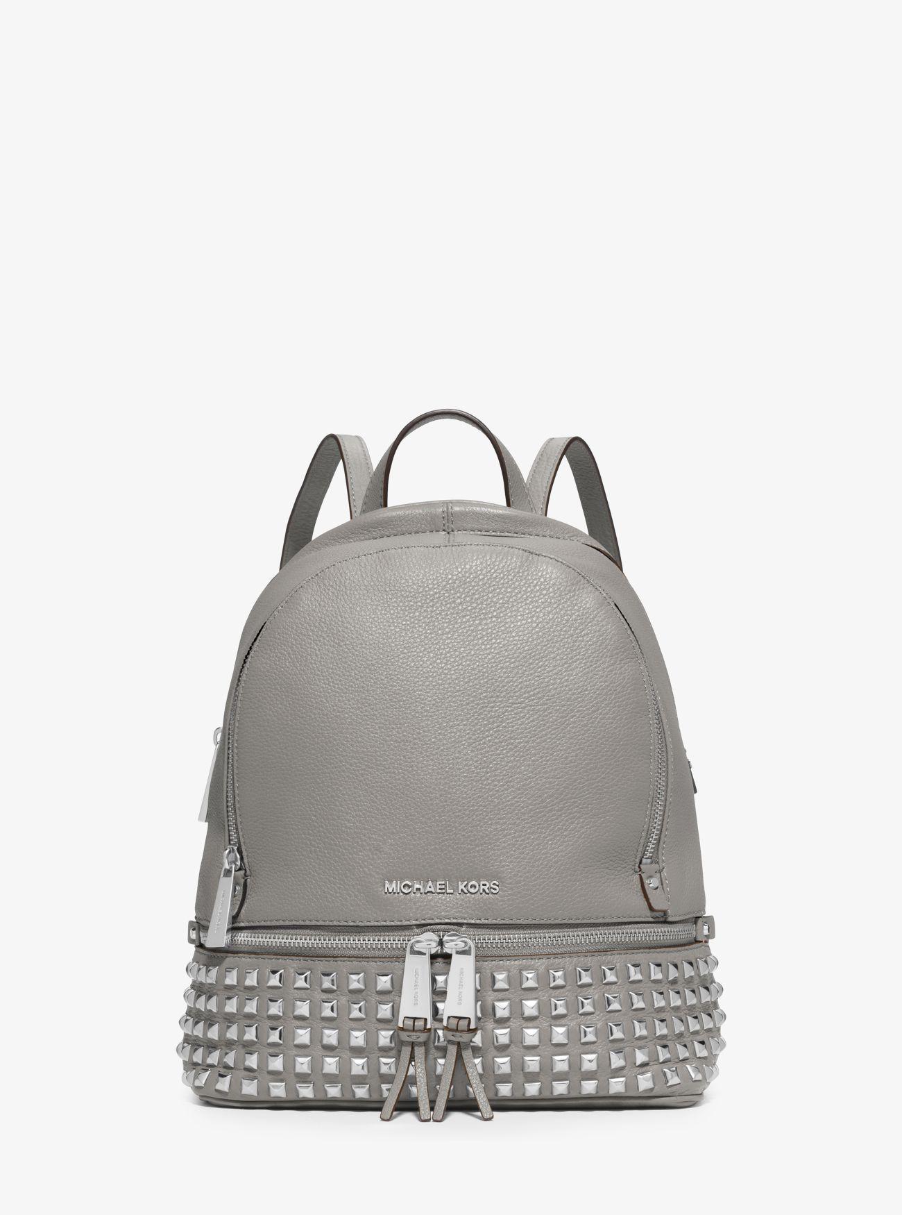 9dac9a68279b Michael Kors - White Rhea Medium Studded Pebbled Leather Backpack - Lyst.  View fullscreen