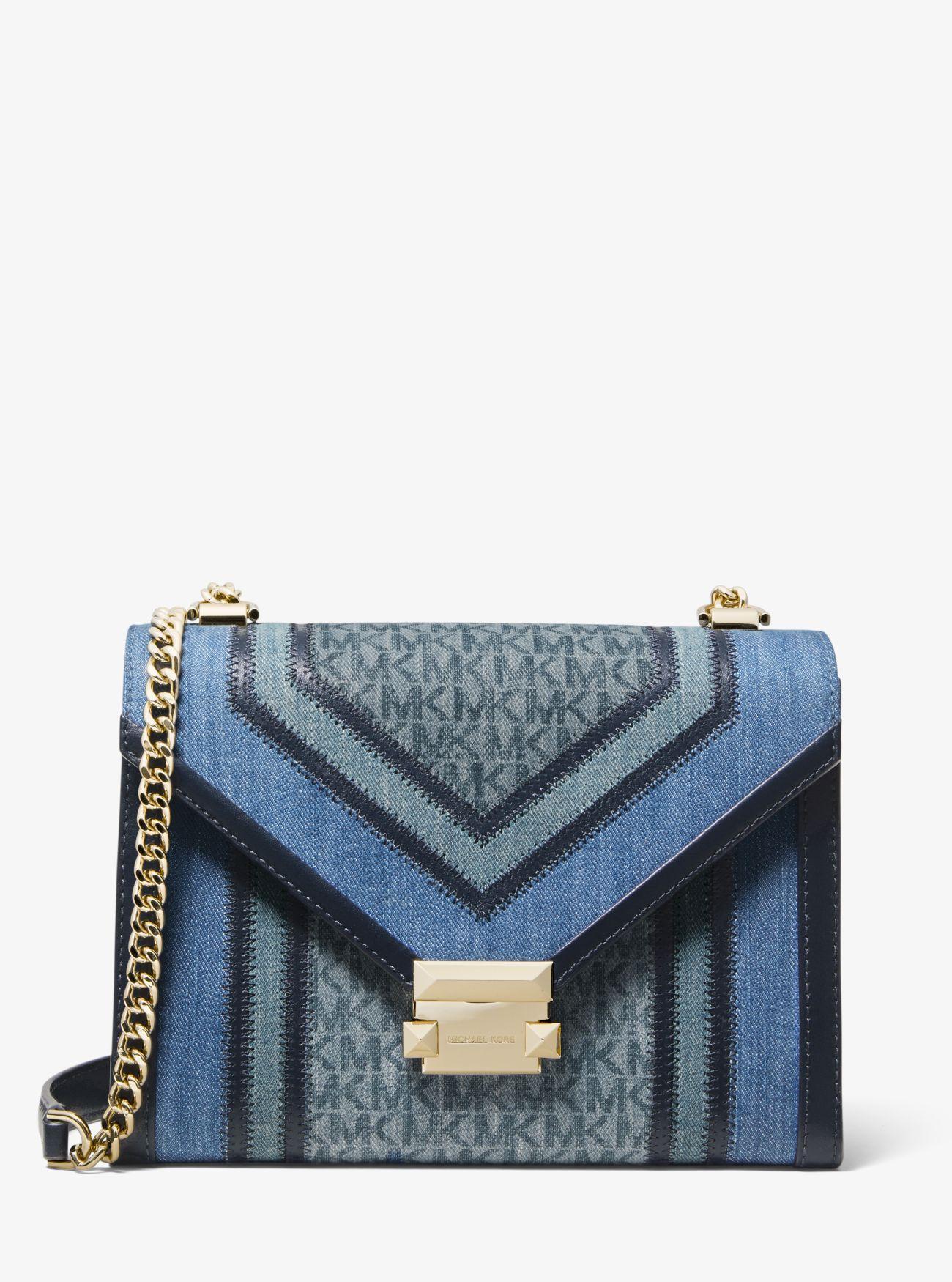 15630e14f0e3 Michael Kors. Women s Blue Whitney Large Denim Logo Convertible Shoulder Bag