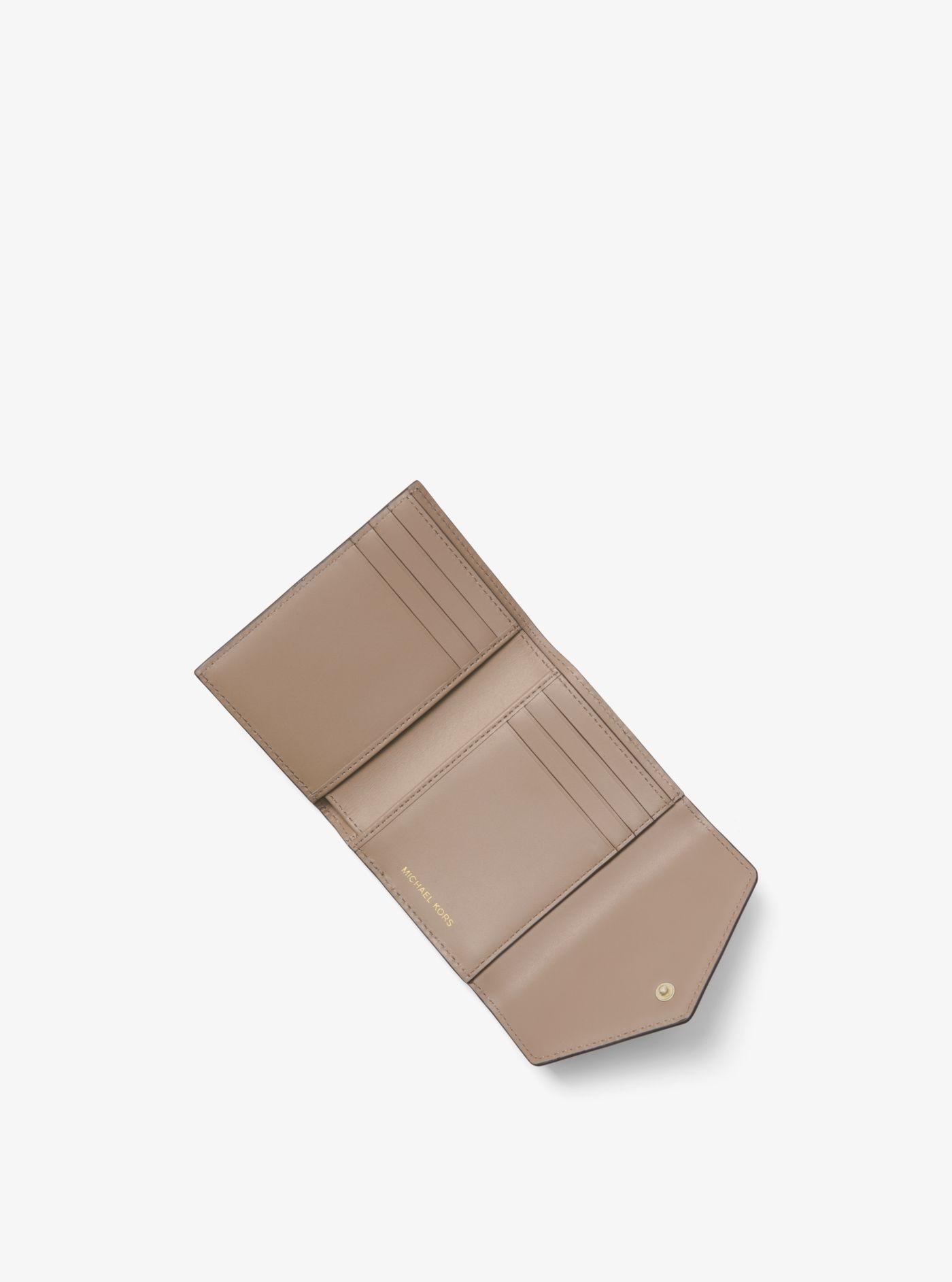 694e4e237e4df Michael Kors - Brown Petit portefeuille enveloppe Jet Set en cuir - Lyst.  Afficher en plein écran
