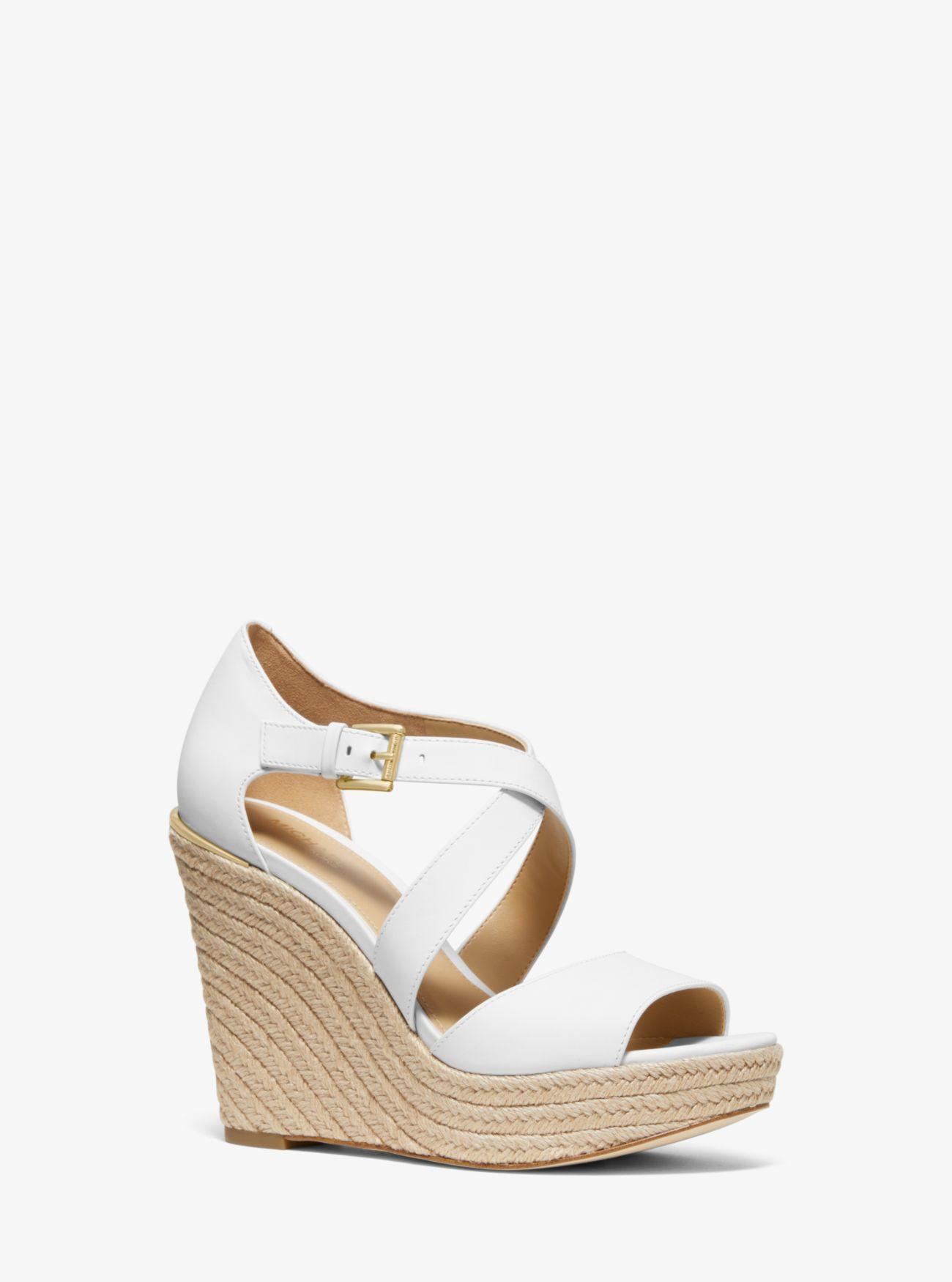 6c52541d8a1 Michael Kors Abbott Leather Wedge in White - Lyst