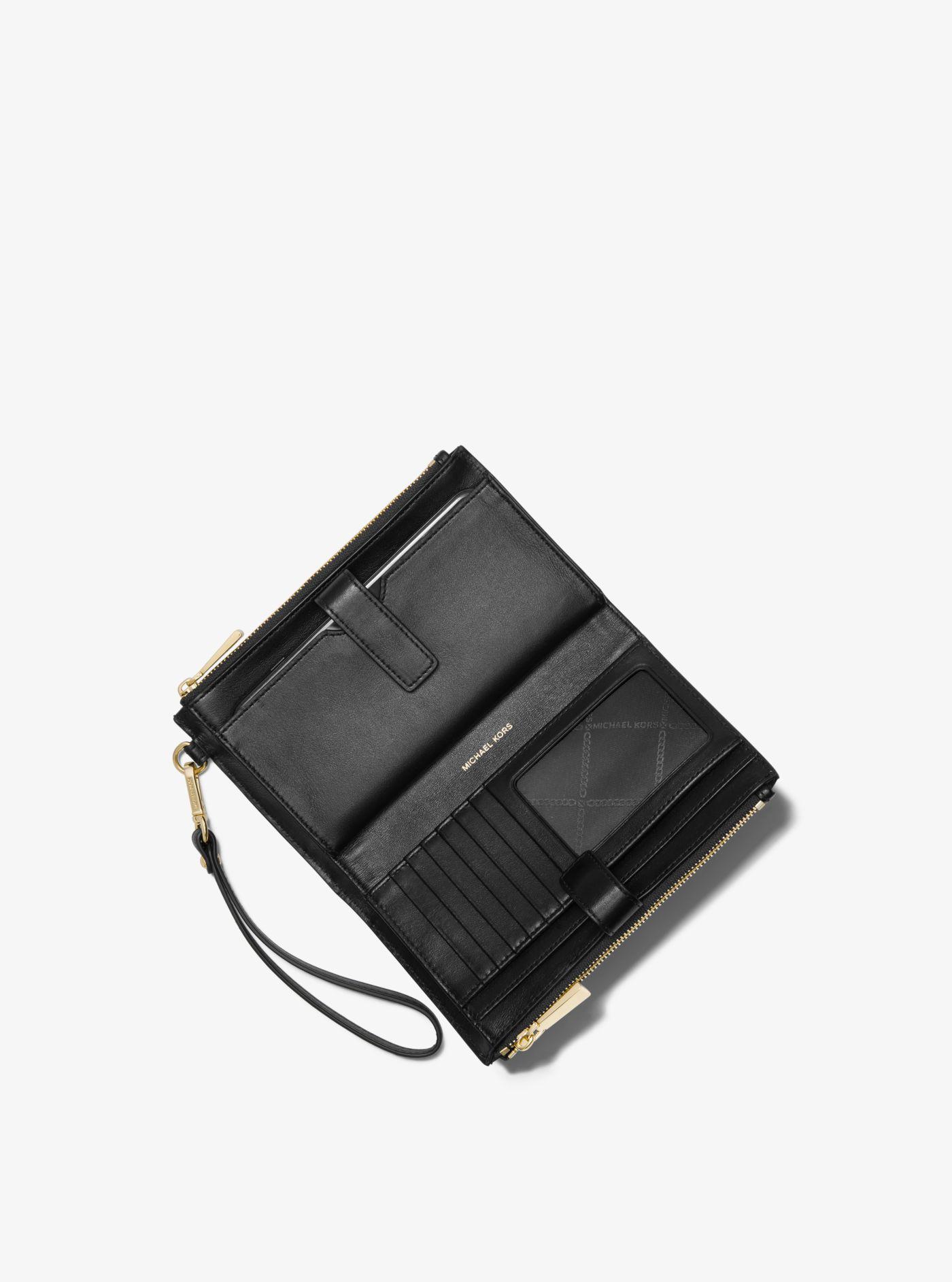 1abd77a9e67ae Michael Kors - Brown Adele Logo Smartphone Wallet - Lyst. View fullscreen