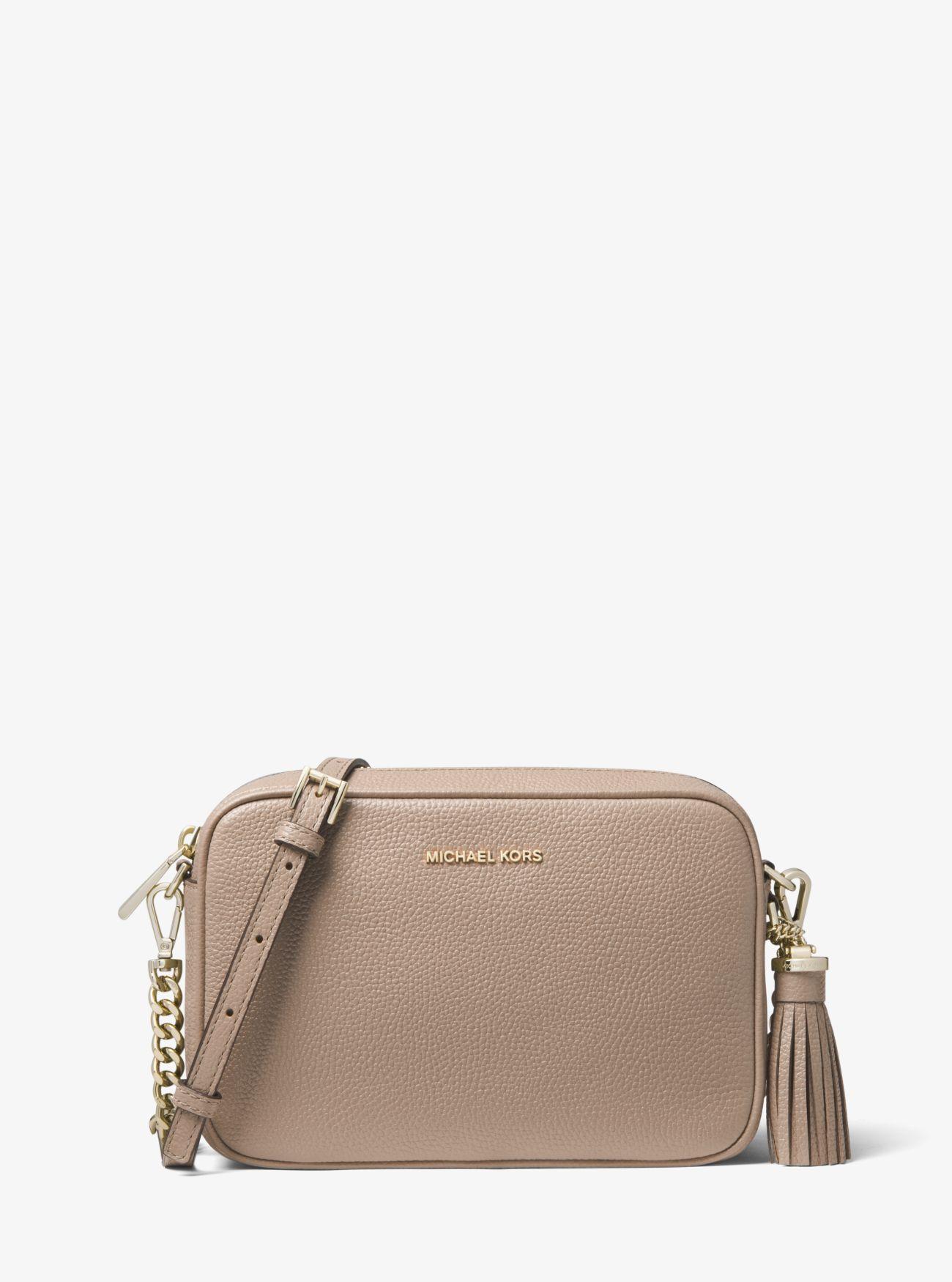 35f7c8ef29611a Michael Kors - Brown Ginny Medium Pebbled Leather Crossbody Bag - Lyst.  View fullscreen