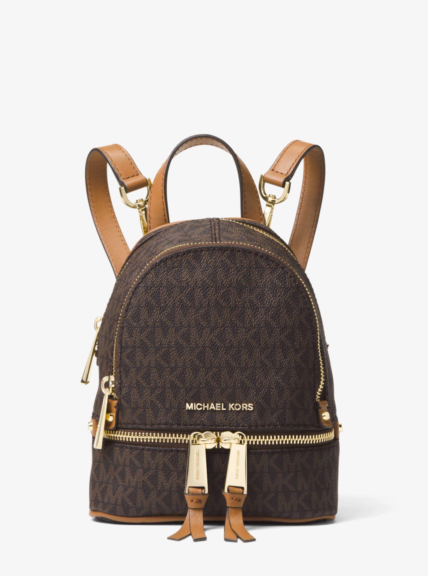lyst michael kors rhea mini logo backpack in brown rh lyst com michael kors mini backpack brown michael kors brown backpack sale