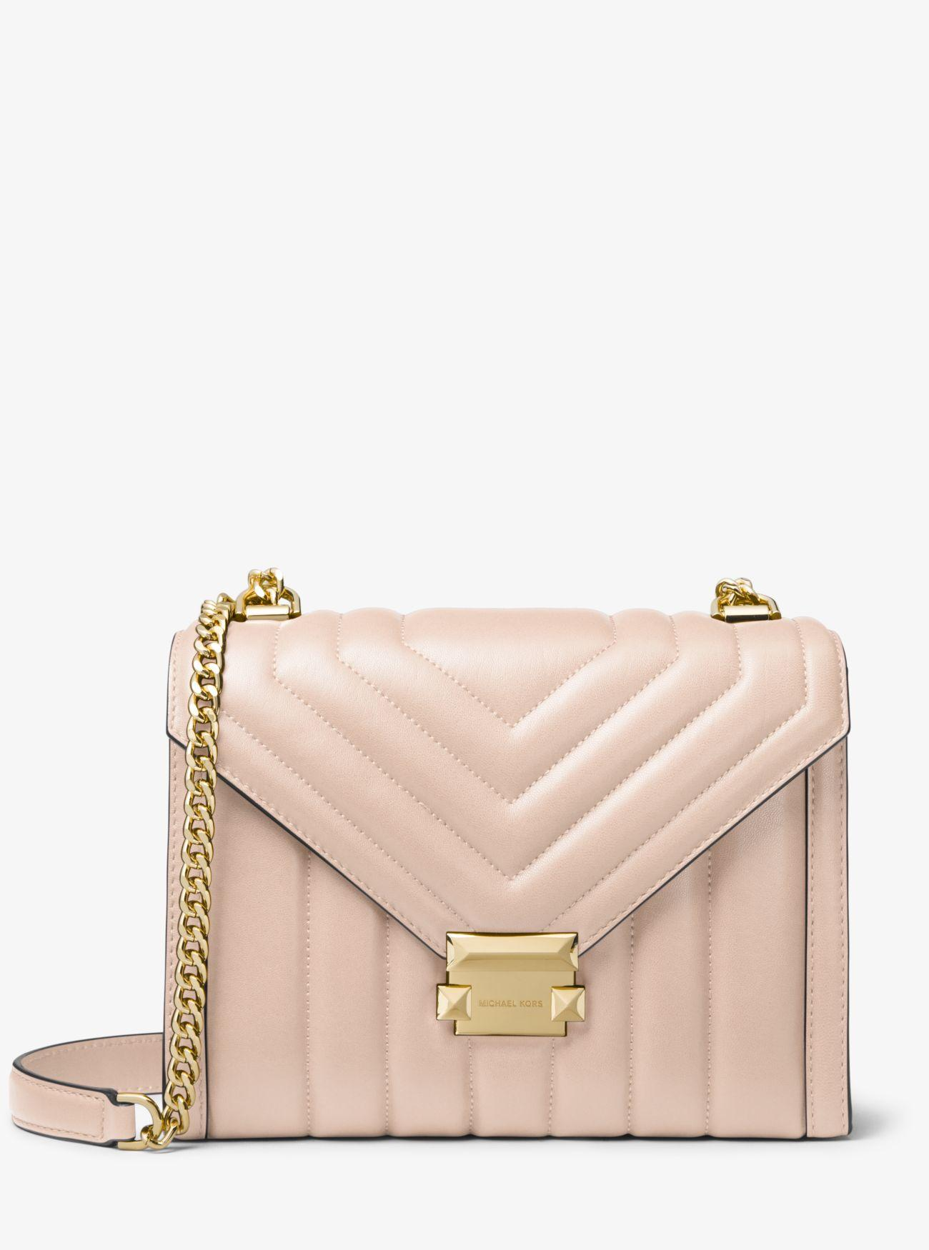 0ed387f815a7 Michael Kors. Women s Pink Whitney Large Quilted Leather Convertible  Shoulder Bag