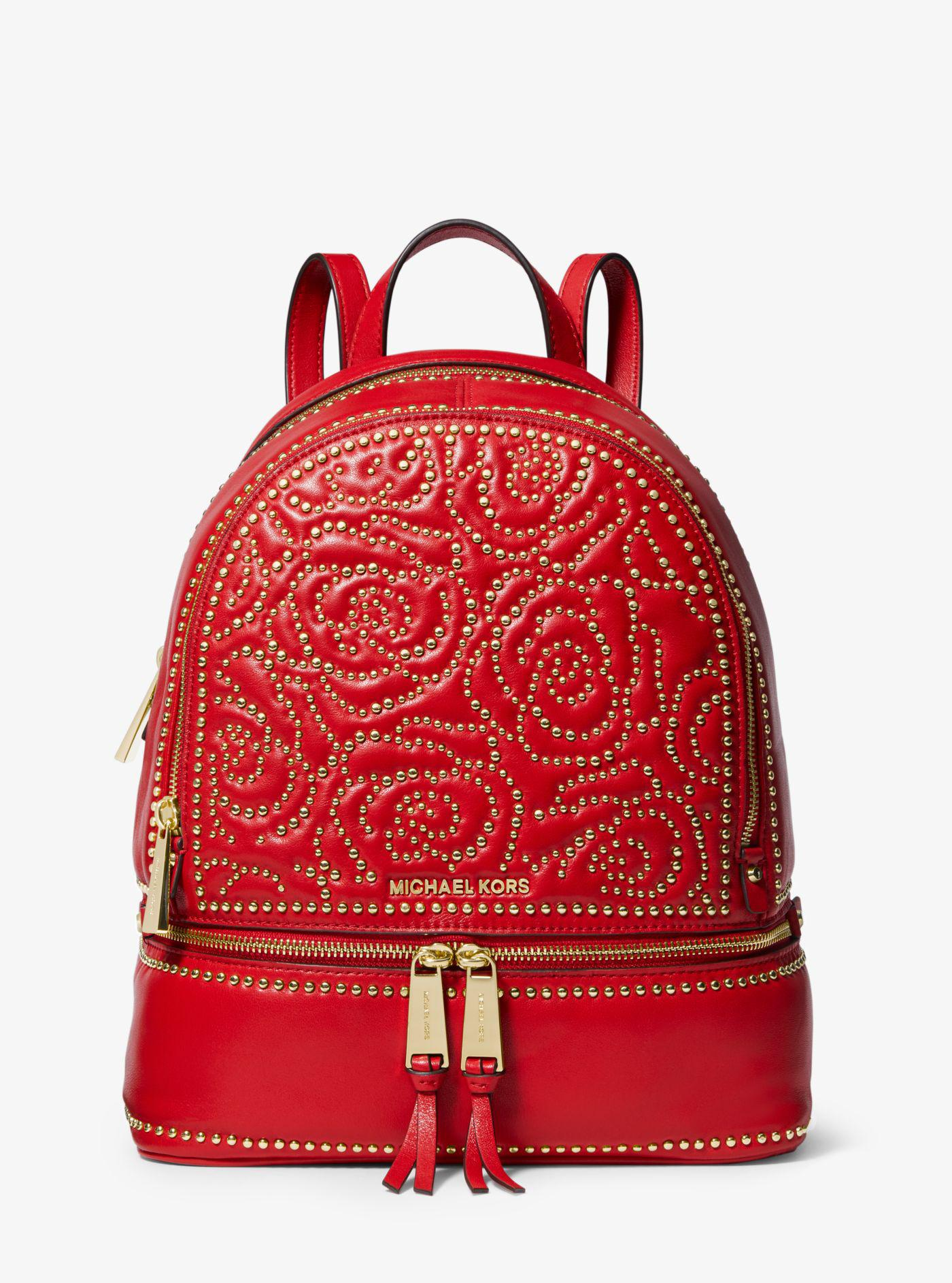 34aa6c6e29ad ... ireland michael kors red rhea medium rose studded leather backpack lyst.  view fullscreen b9ee3 866a7
