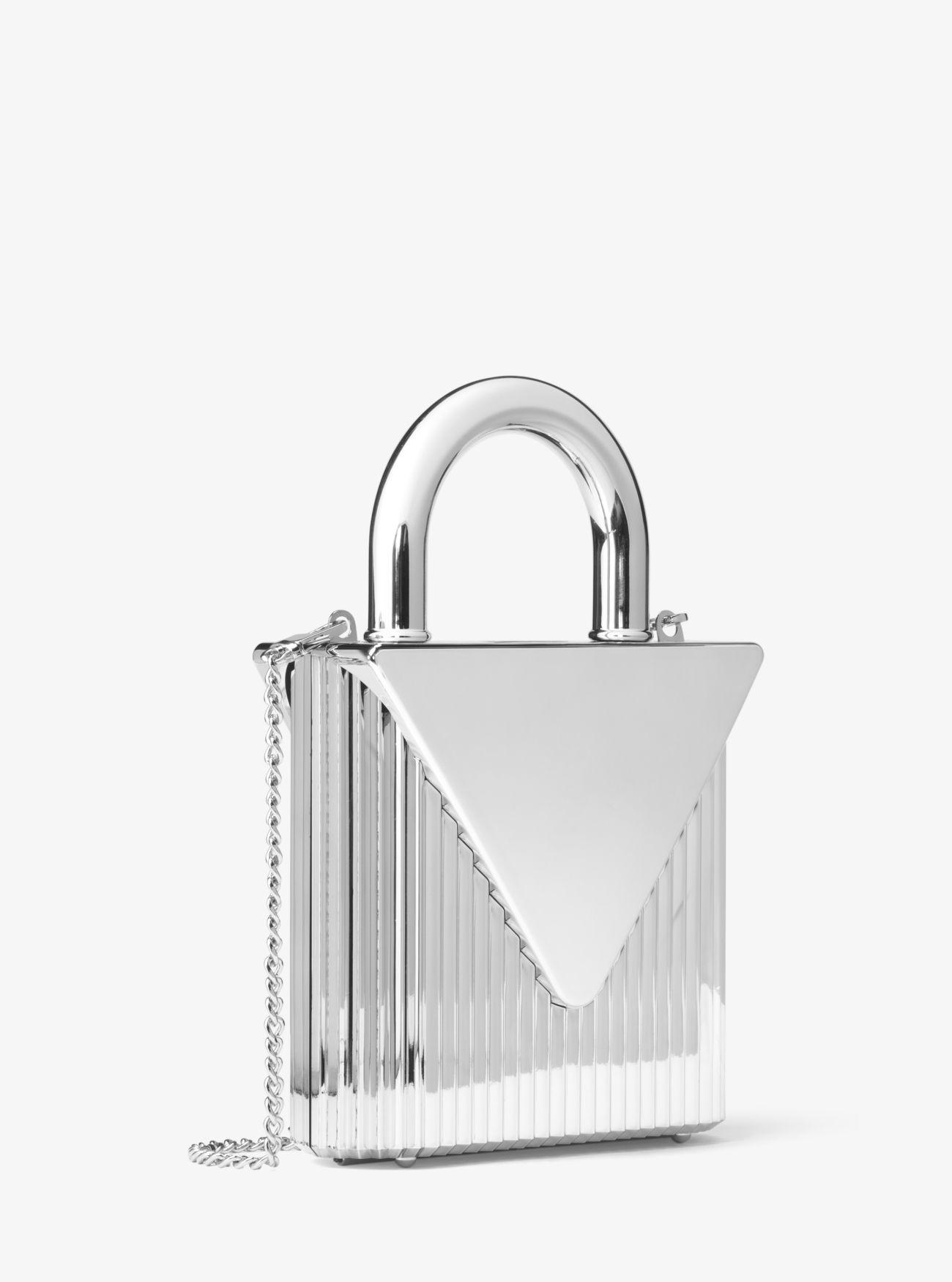 3c4f21604d17 Lyst - Michael Kors Mercer Lock Clutch in Metallic