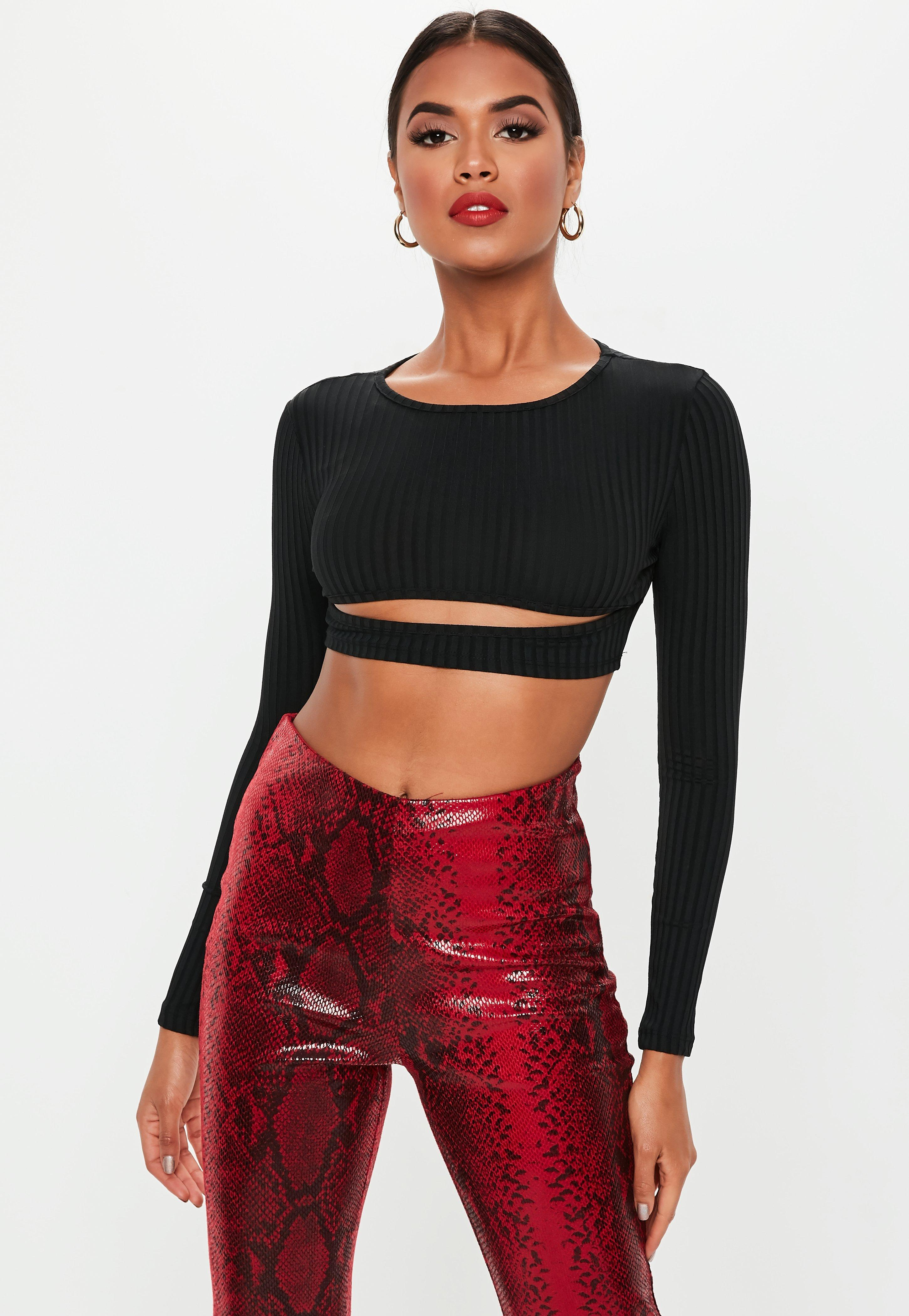 23bf2d06027 Lyst - Missguided Petite Black Ribbed Cut Out Long Sleeve Crop Top ...
