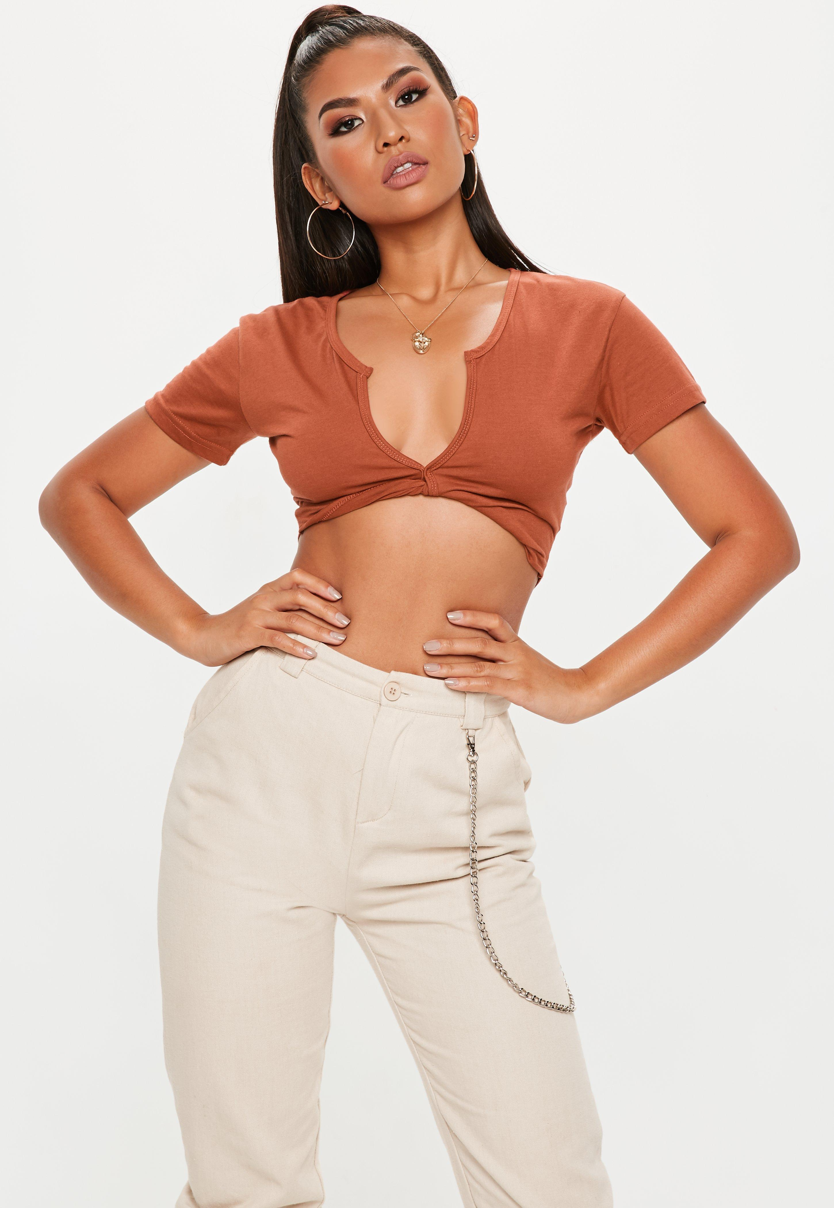 6c6aa440a263c Lyst - Missguided Rust Short Sleeve Twist Front Crop Top in Brown