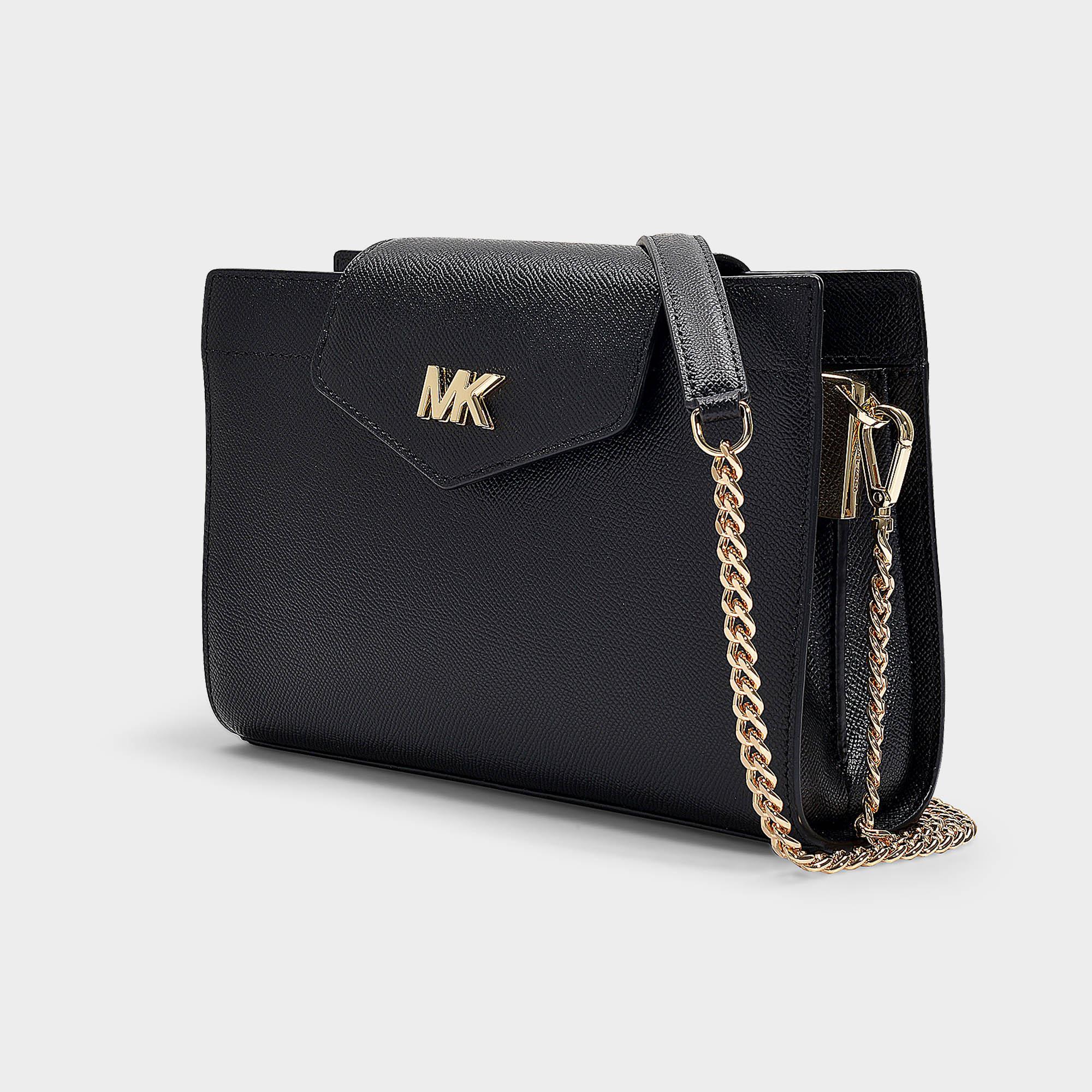 11b659bd91f101 MICHAEL Michael Kors - Crossbodies Large Convertible Crossbody Clutch Bag  In Black Grained Calfskin - Lyst. View fullscreen