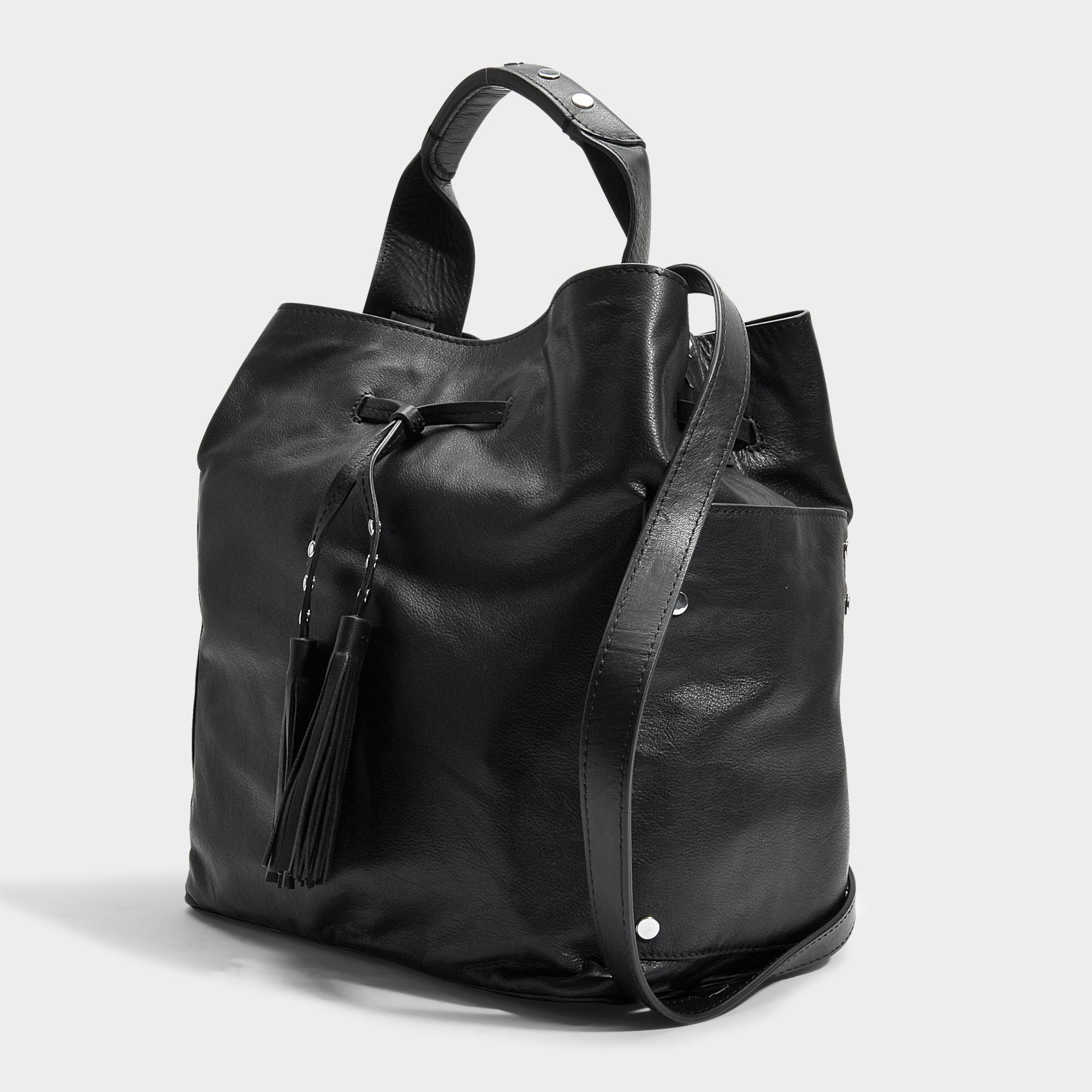 ee7d345f92 Sac saxo bucket en cuir noir Gerard Darel en coloris Noir - Lyst