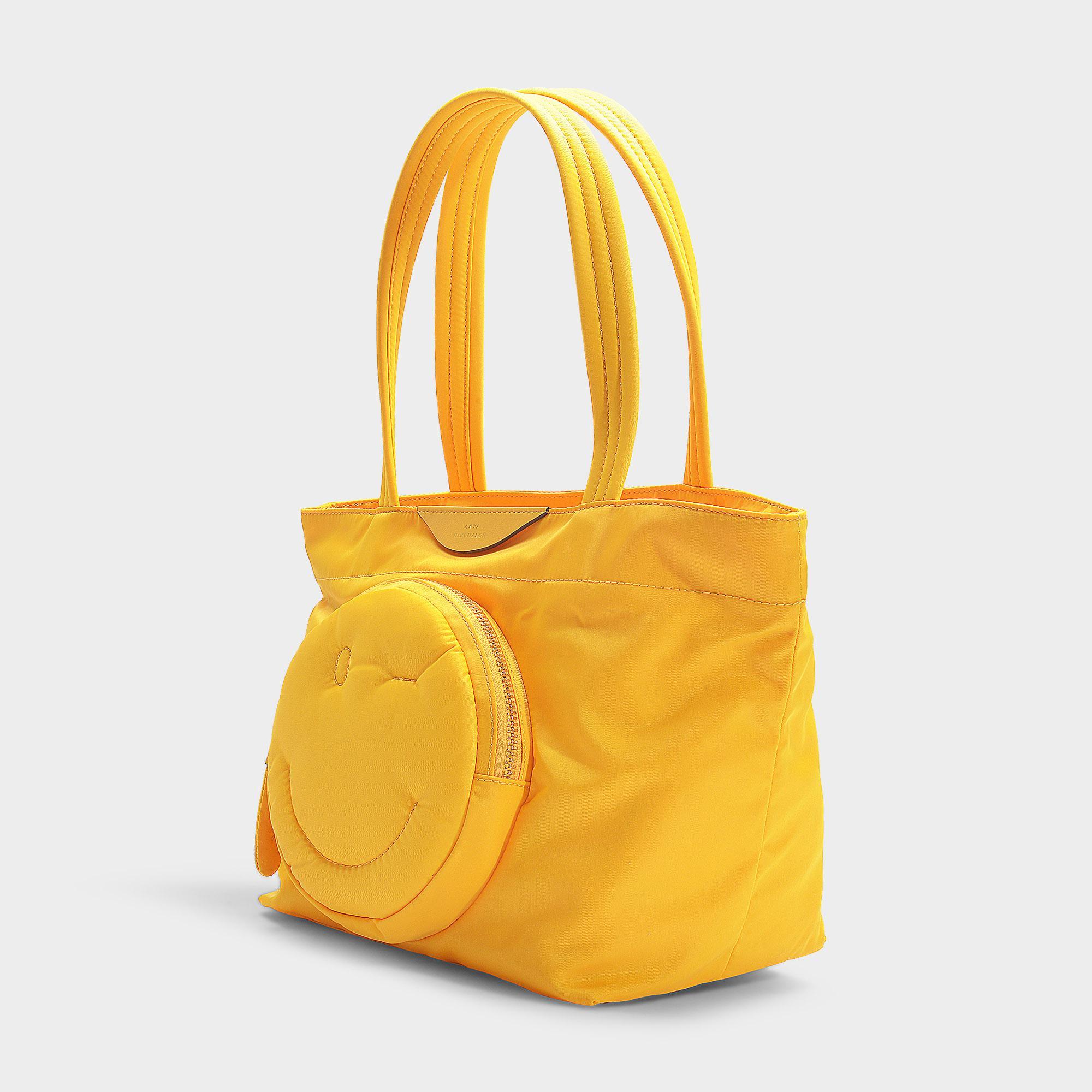 4ec88b6832a anya-hindmarch-Yellow-Chubby-Wink-Mini-Tote-In-Yellow-Nylon.jpeg