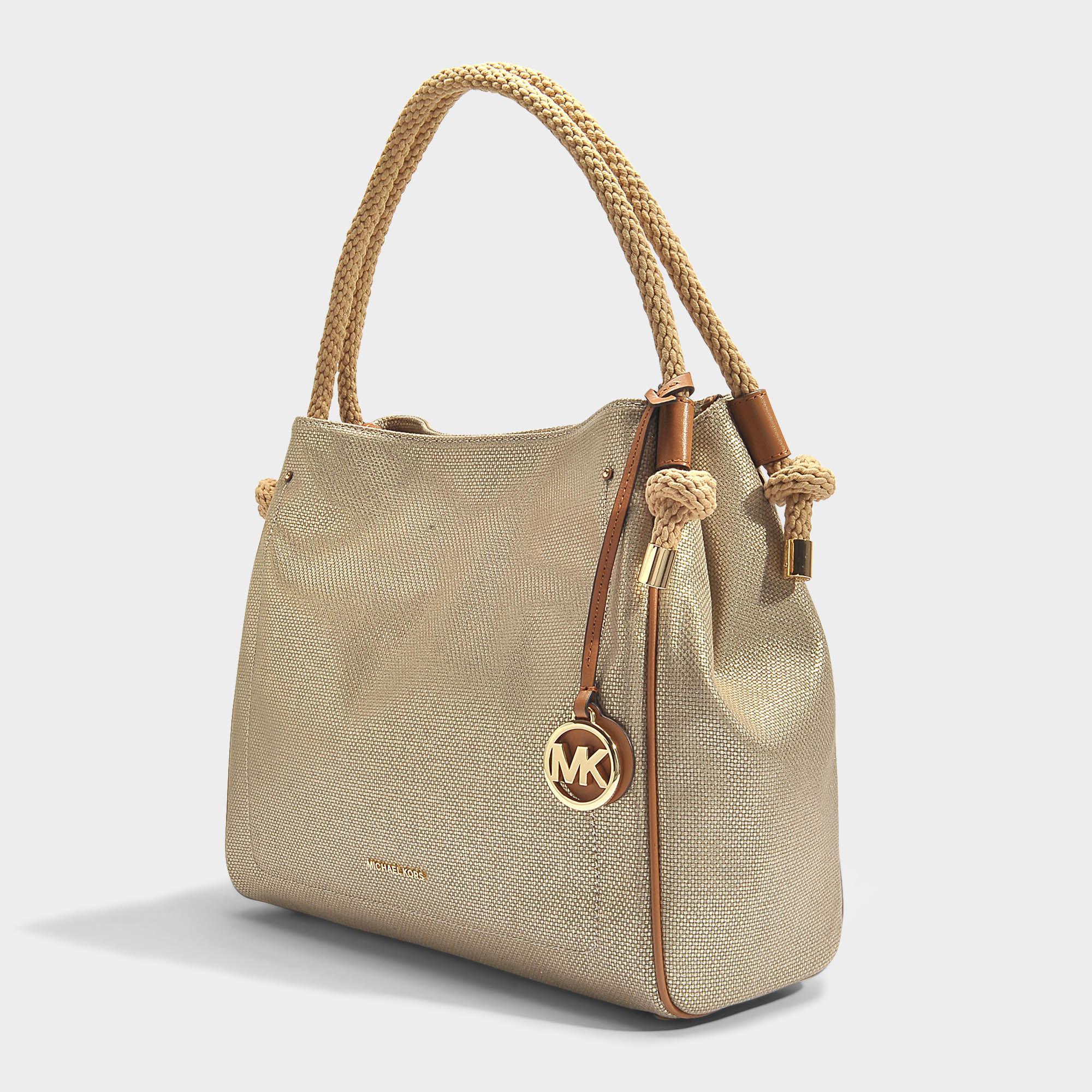 e5a1572570fa Lyst - MICHAEL Michael Kors Isla Large Grab Bag In Pale Gold ...