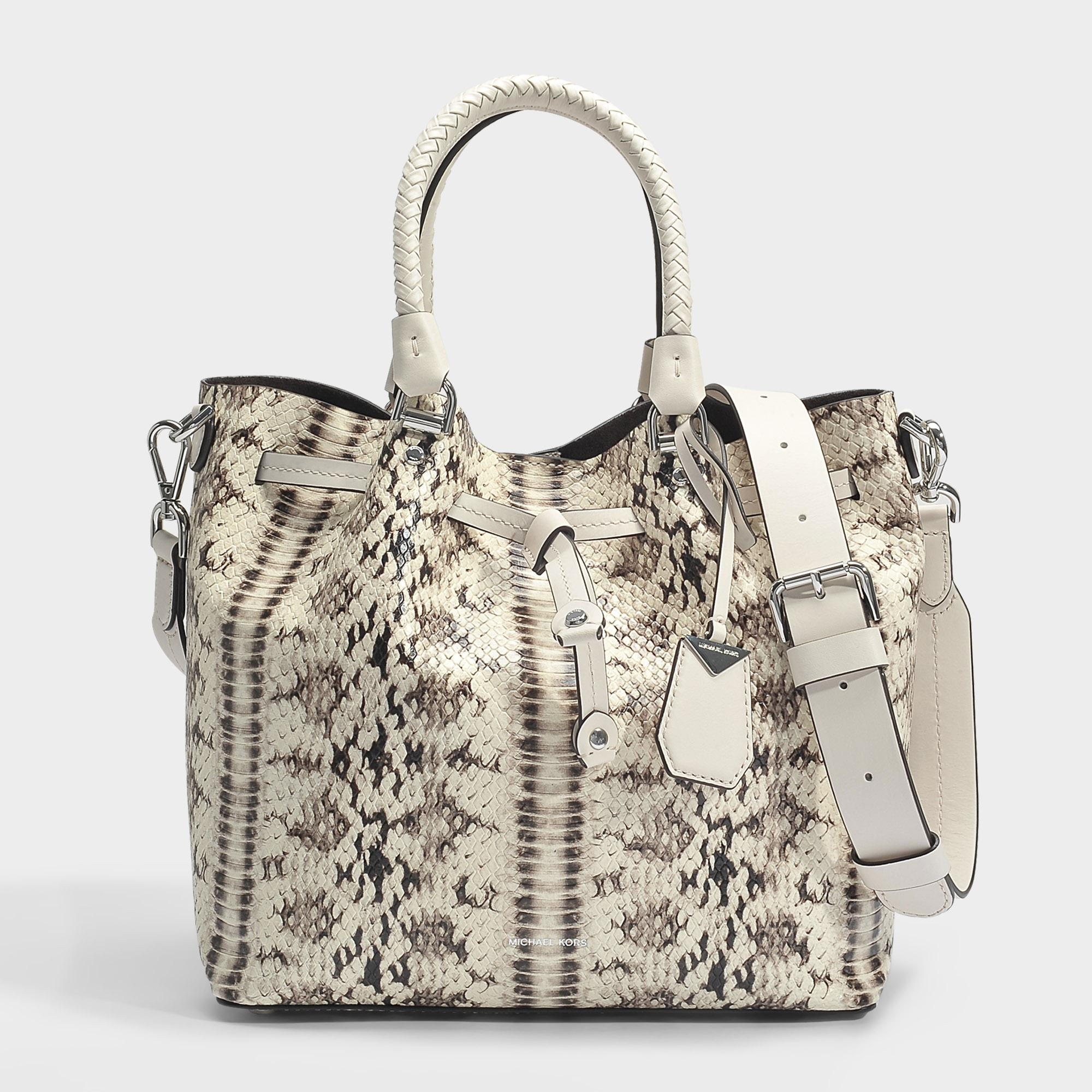 e3c2d24f08f0 ... inexpensive lyst michael michael kors blakely medium bucket bag in  natural and ac28c 0e7d6