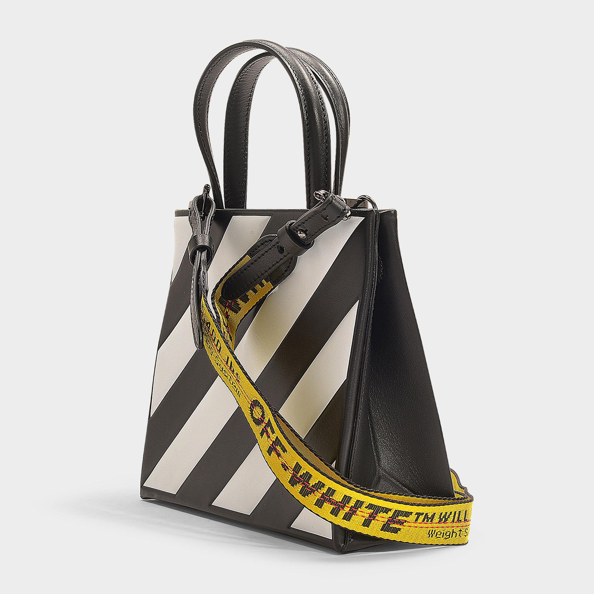 Petit sac à main diag box en cuir de veau noir et blanc femme