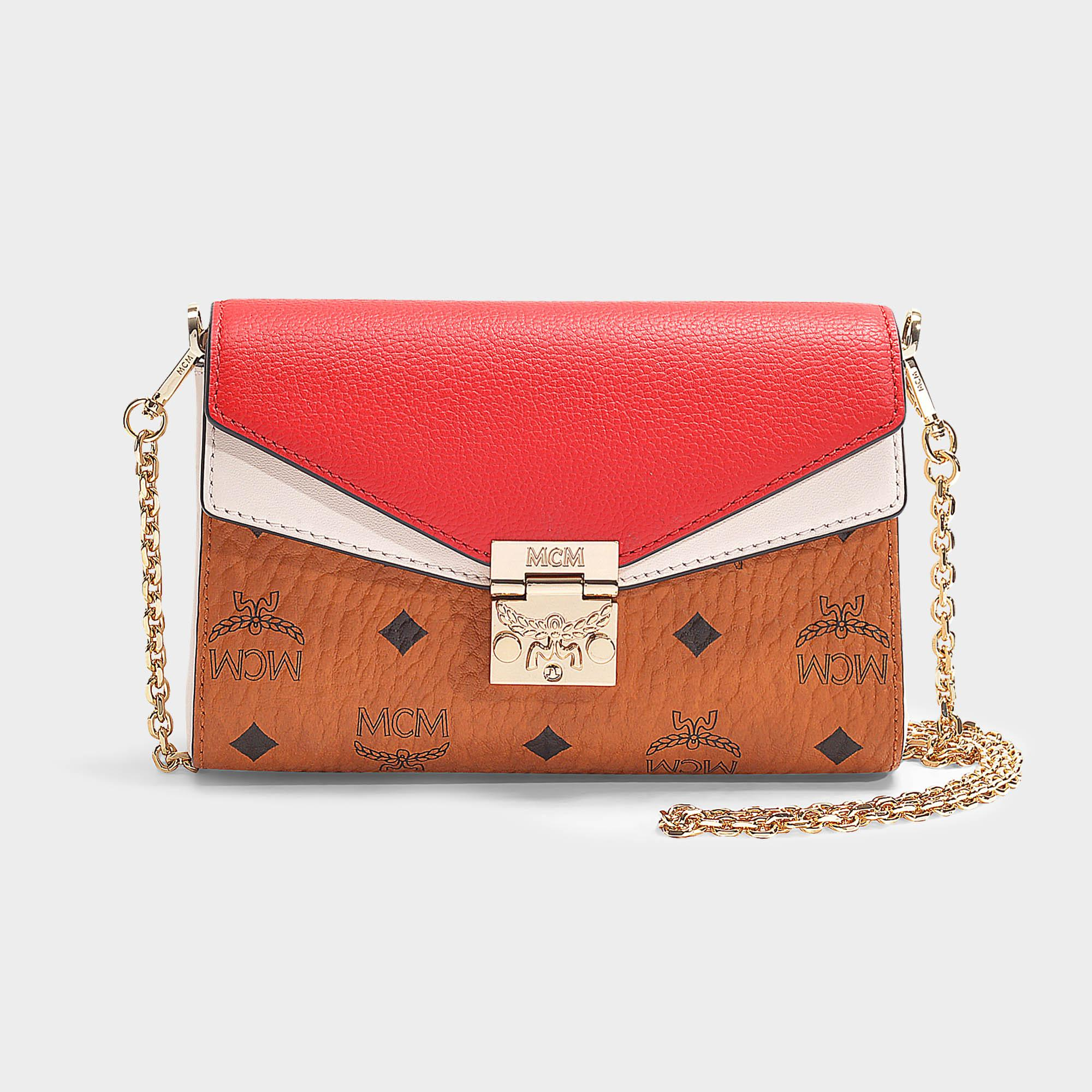 ff5a90aff2 MCM - Millie Visetos Leather Block Small Crossbody Bag In Cognac And Red Coated  Canvas -. View fullscreen