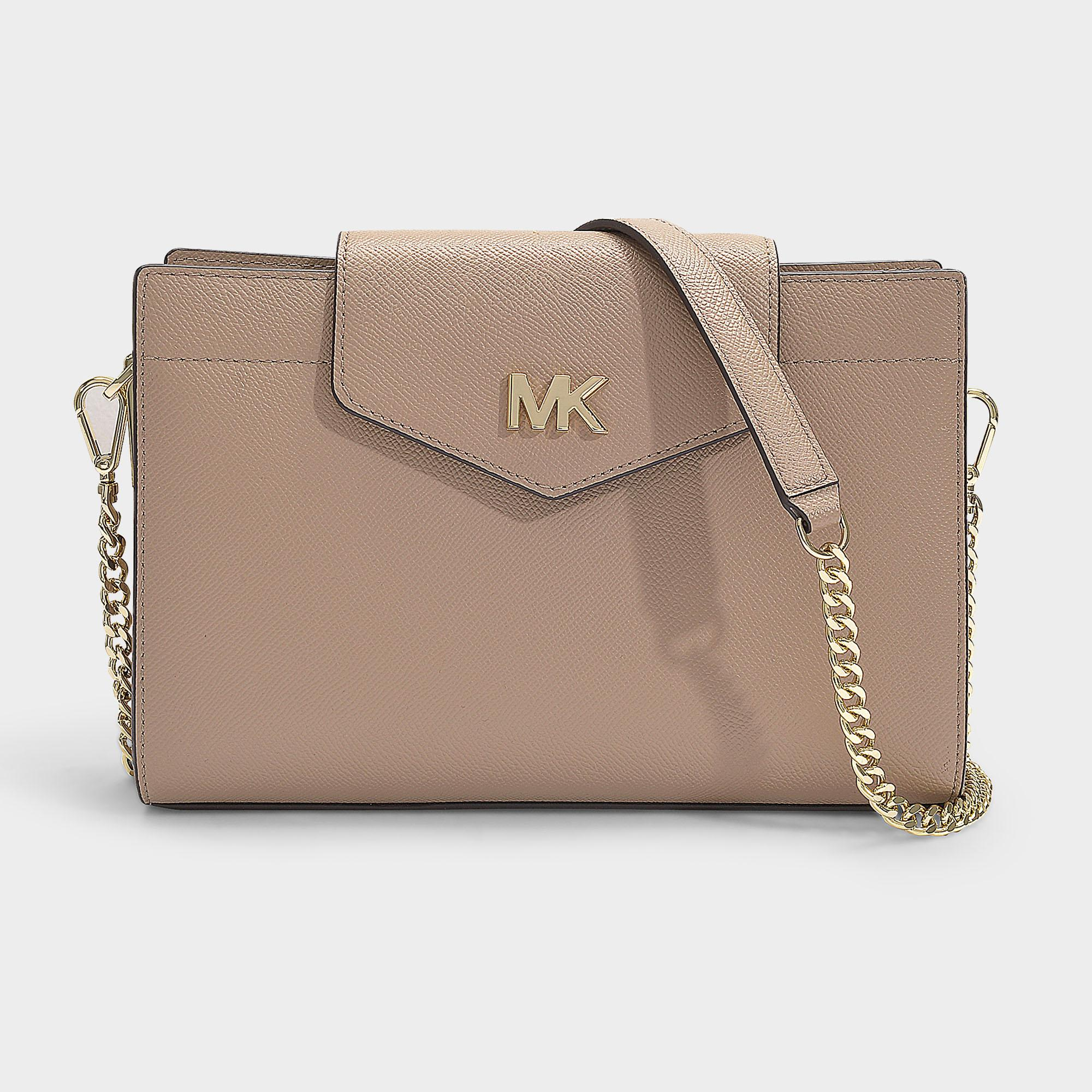 6b103e37b863 MICHAEL Michael Kors. Women s Natural Crossbodies Large Convertible Crossbody  Clutch ...
